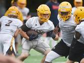 See images from the first day of high school football practice at IC Catholic Prep, Batavia, Fremd, and Carmel.