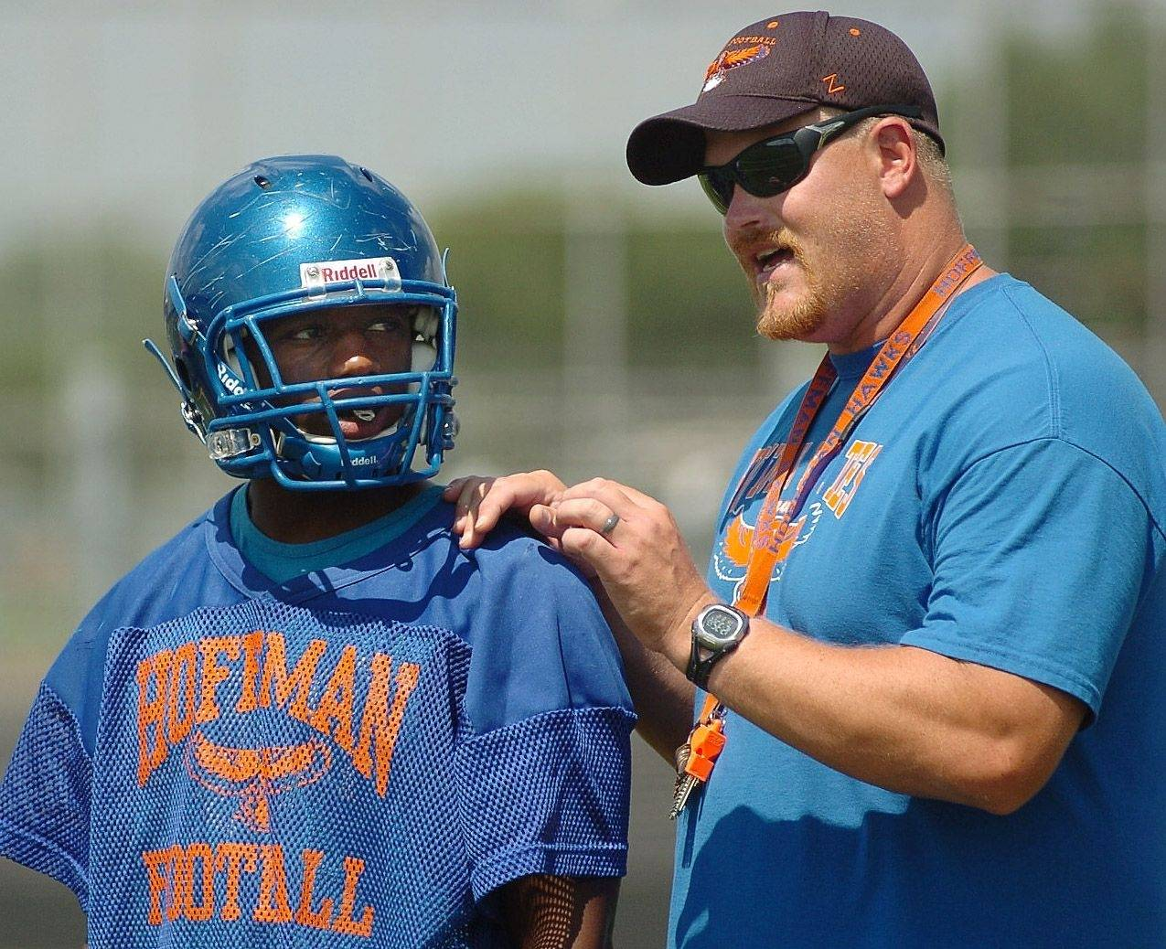 Hoffman Estates offensive coordinator Joe Lewnandowski with running back Michael Reeves during football practice.