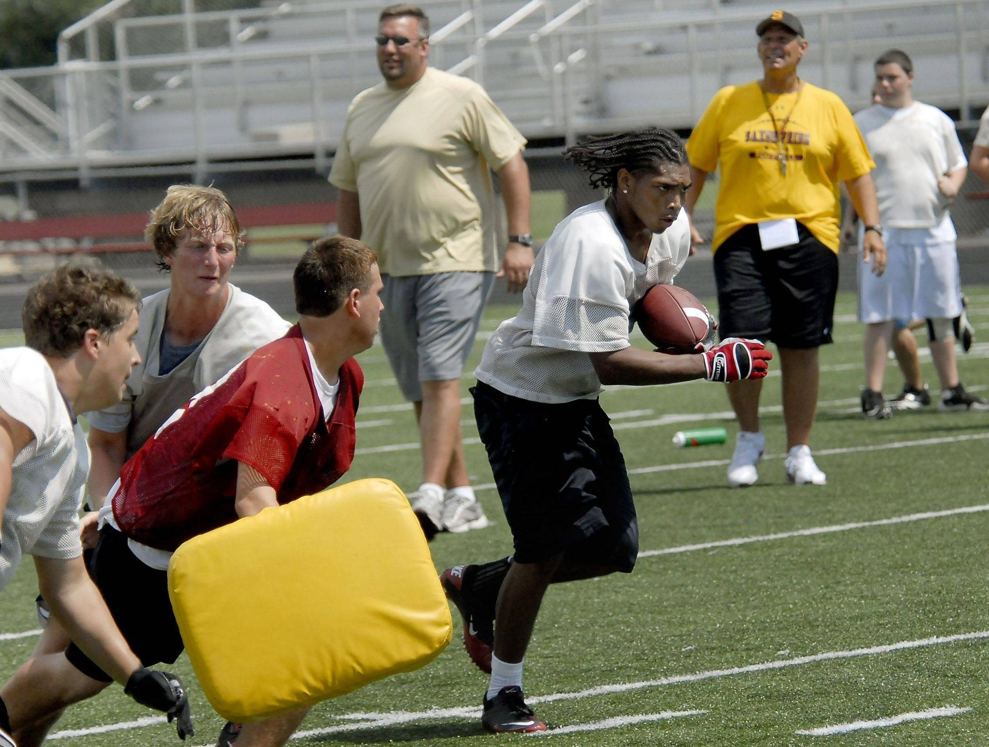 Coaches with a play Friday at the Schaumburg Varsity football practice.