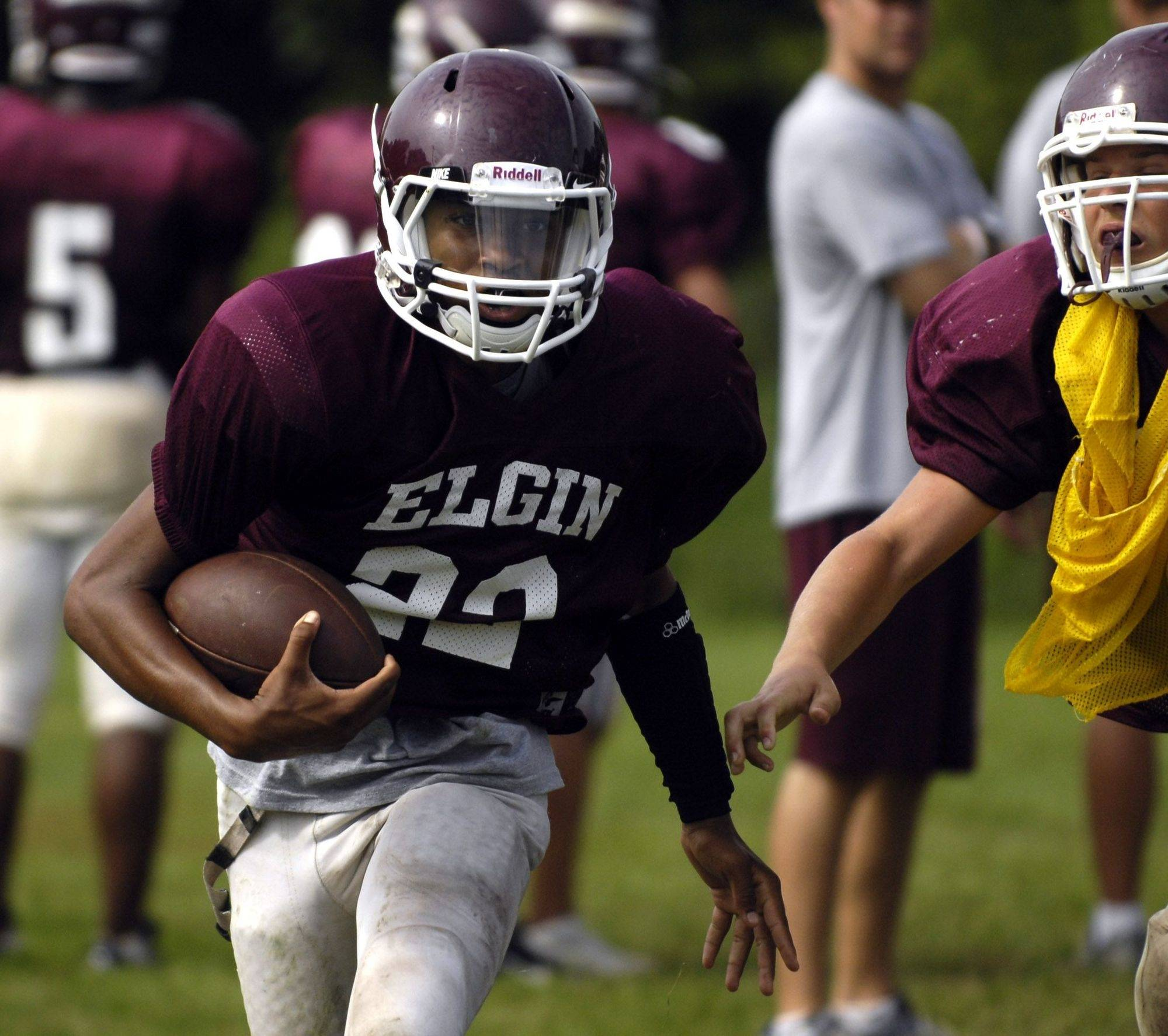 Devin Simon gets upfield during preseason football practice at Elgin High School Wednesday.