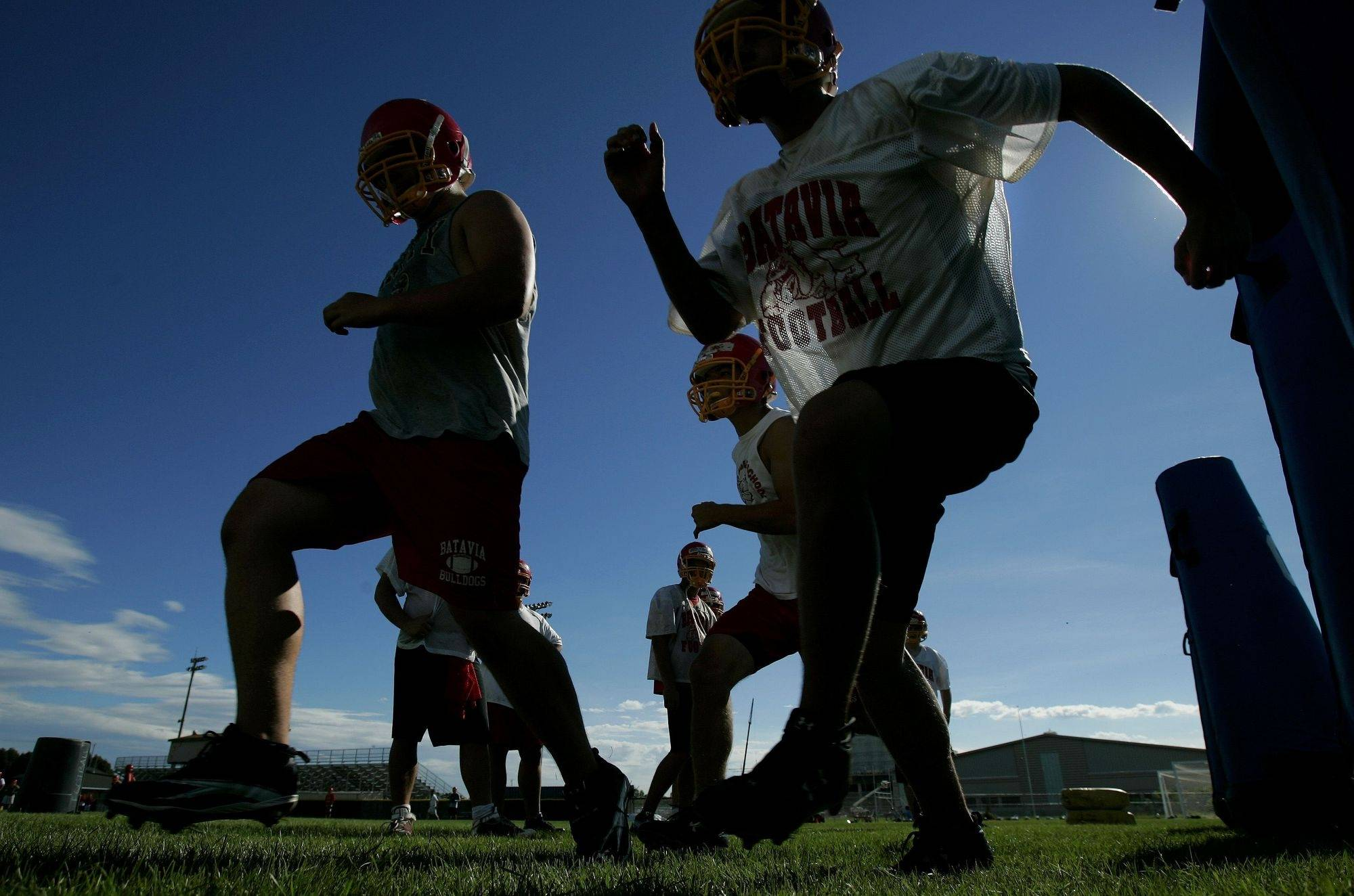 Athletes run drills during the first day of football practice Wednesday, August 11, 2010 at Batavia High School.