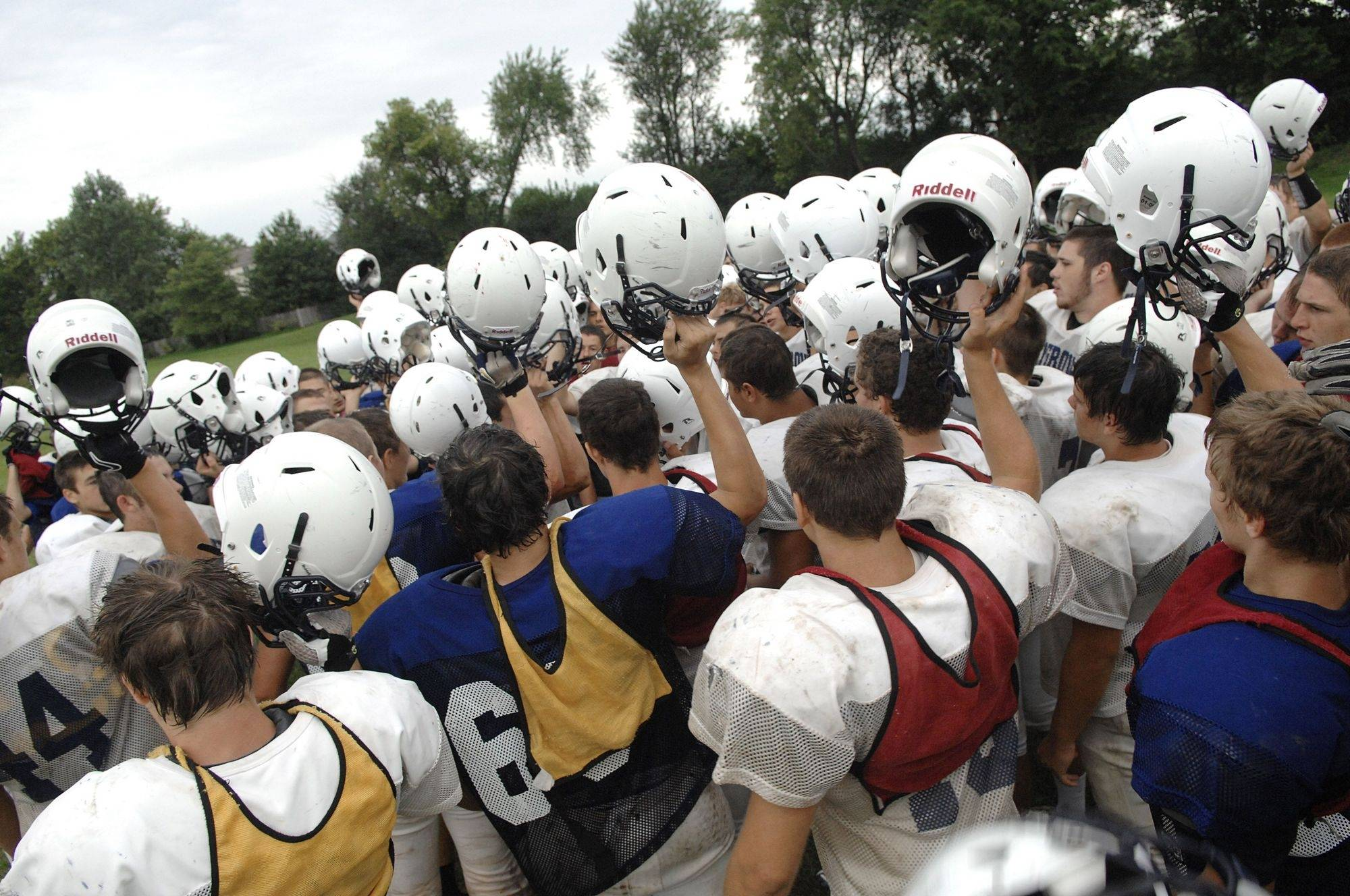 Cary-Grove varsity football players group before ending practice on Tuesday, August 17.