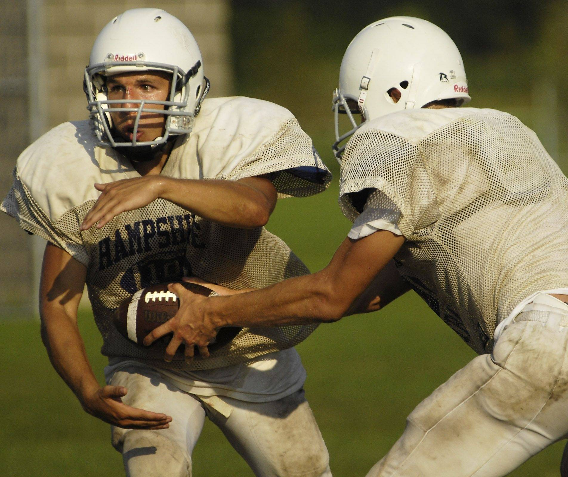 Running back Mike Kuefner takes the ball during Hampshire High School football practice.