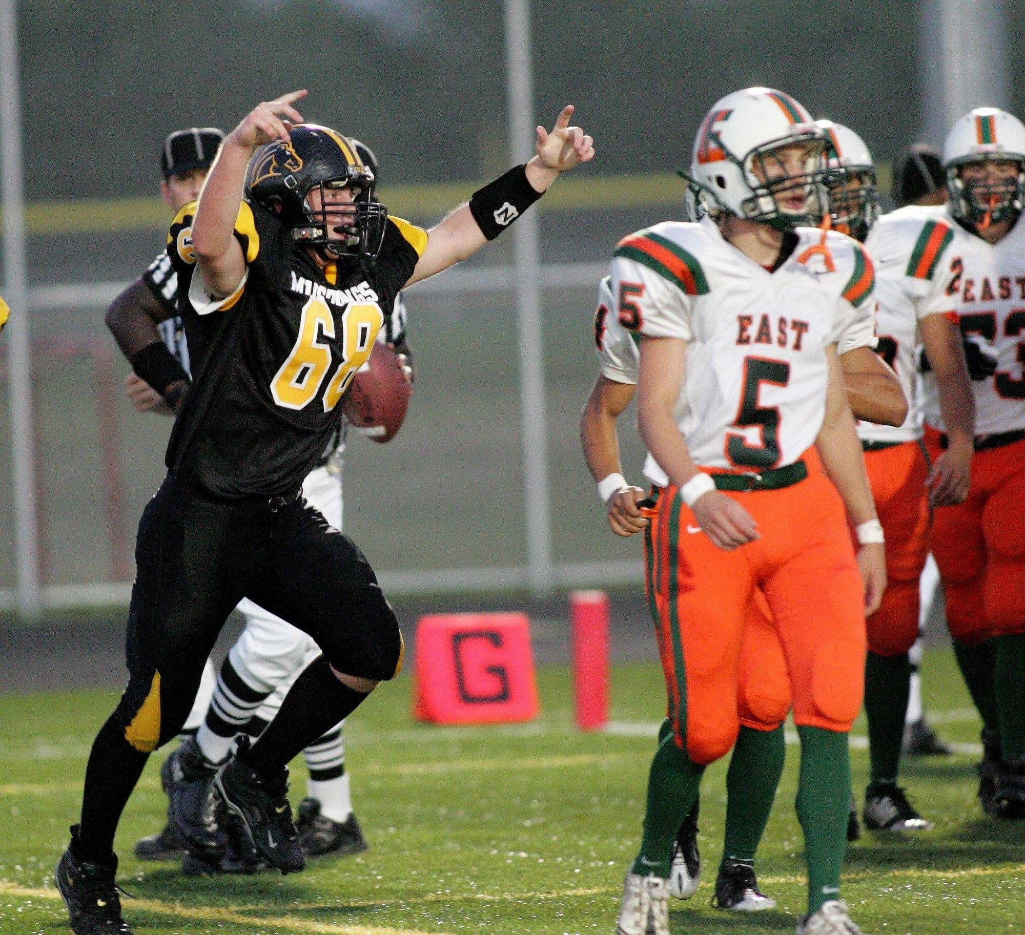 WEEK 1- Matt Stewart of Metea Valley celebrates after the first touchdown for the Mustangs by Alex Hagemaster against Plainfield East.