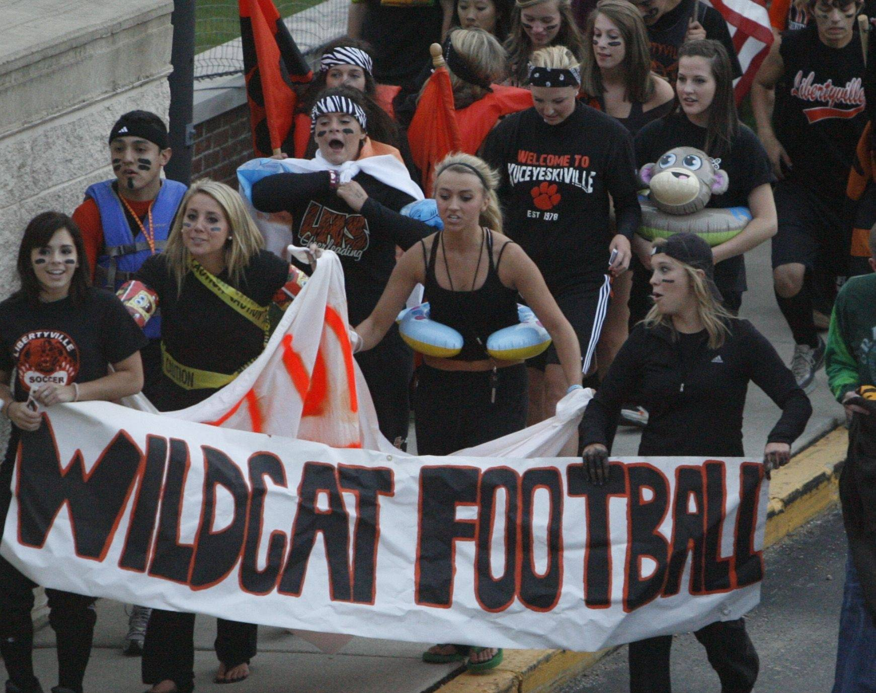 WEEK 2- Libertyville fans march to watch their team play Carmel.