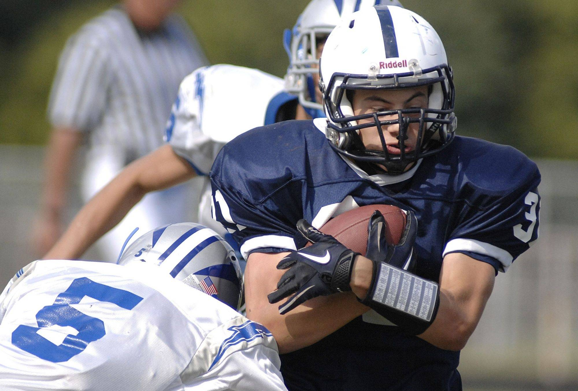 Cary-Grove's Ryan Mahoney is tackled by Woodstock's Jake Graff Ponstein in the first half on Saturday, September 11.