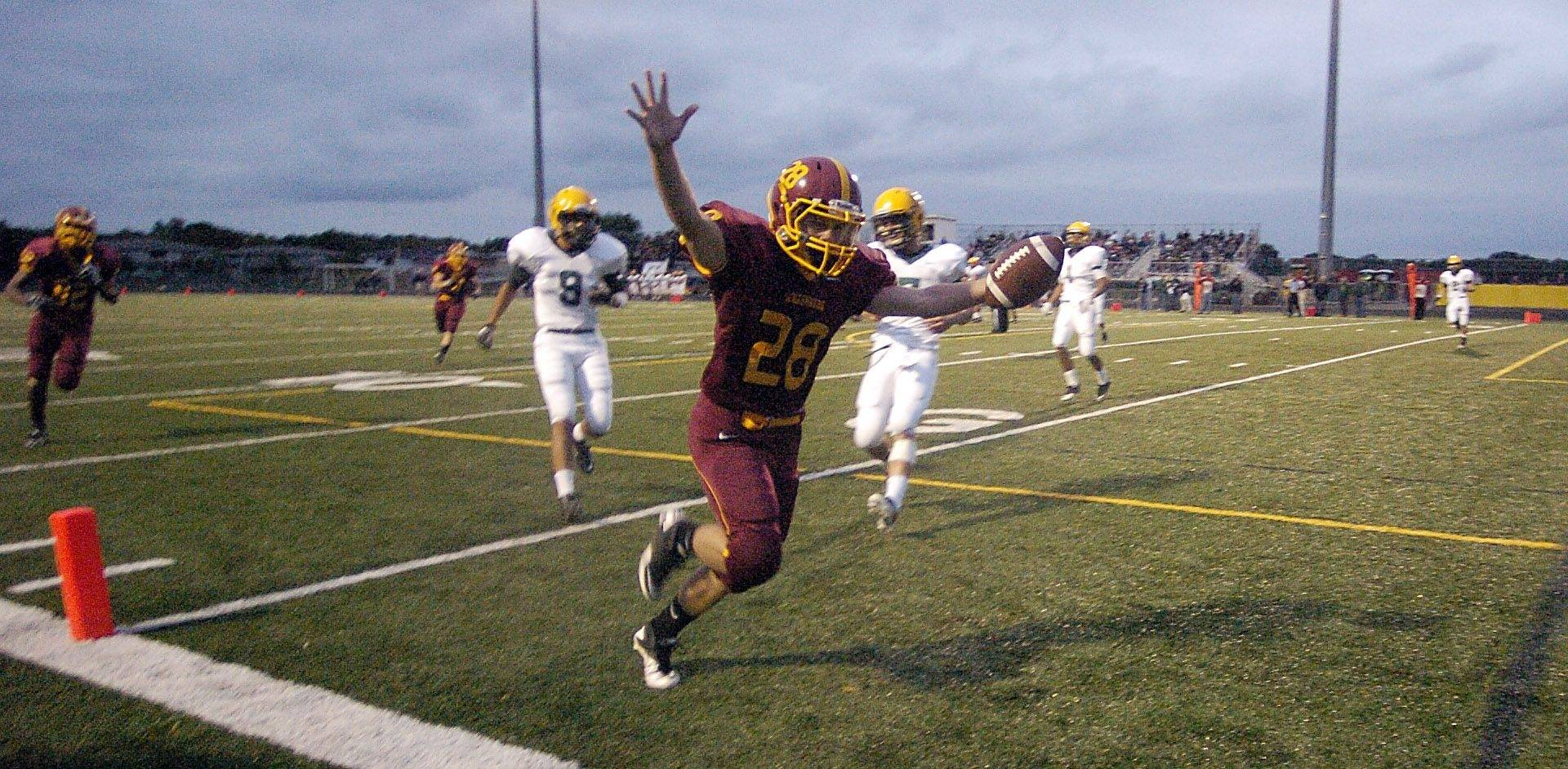 WEEK 4- Schaumburg's Kyle Lamberty scores against Elk Grove.