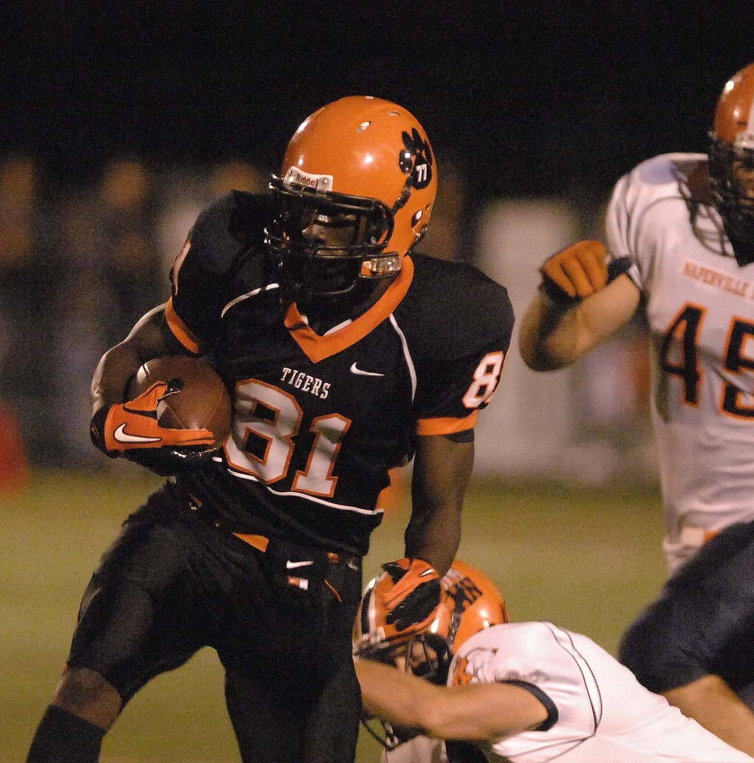 WEEK 5- Davis Titus of Wheaton Warrenville South moves the ball against Naperville North.