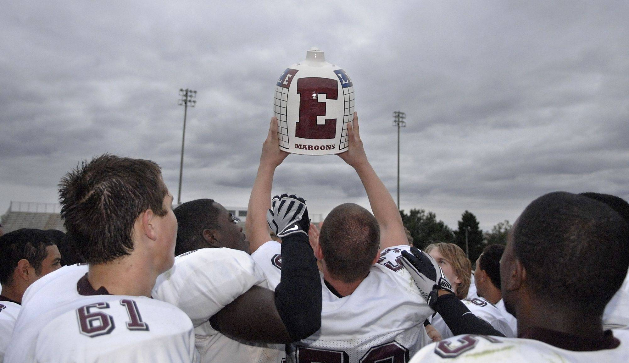 Elgin's D.J. Riggio hoists the jug overhead in the Maroons victory over Larkin on Saturday, September 25.
