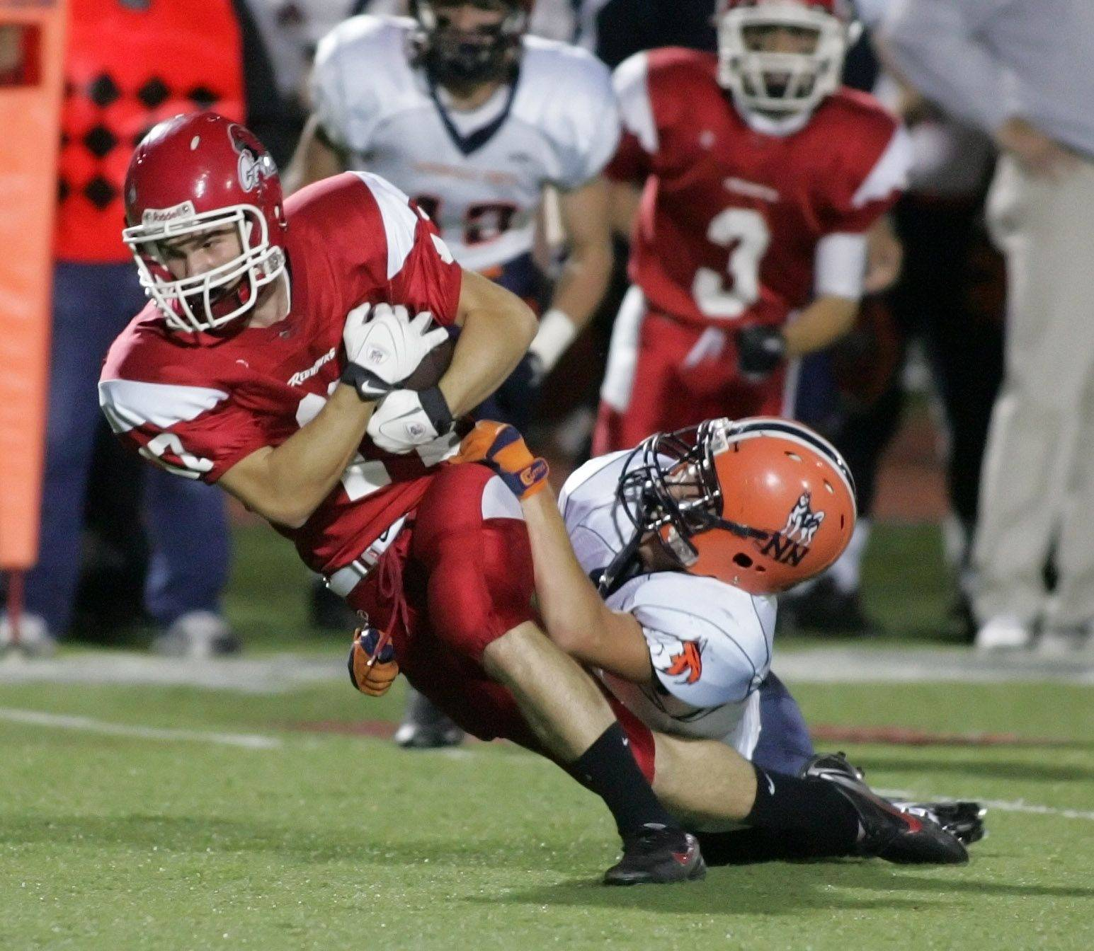 WEEK 6- Mark Bergin of Naperville North, right, tackles Nathan Laskowski of Naperville Central.
