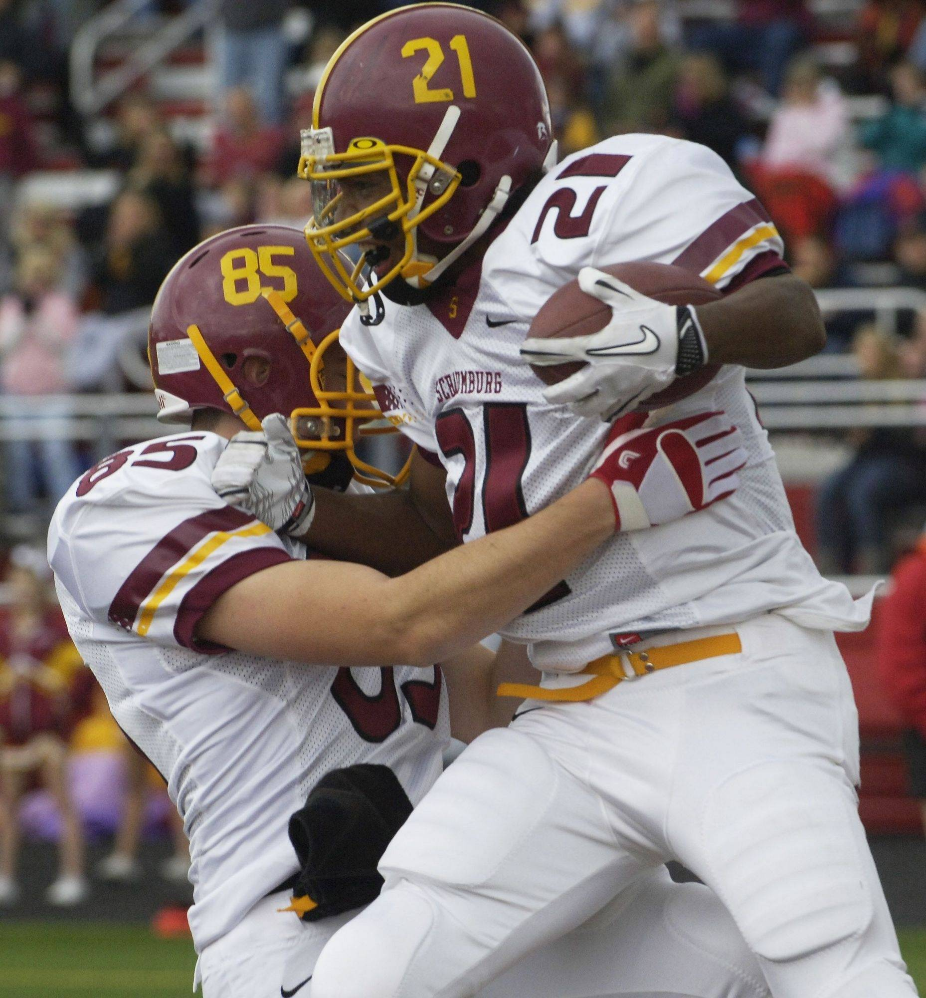 Schaumburg's Shepard Little, right, celebrates his touchdown with teammate Matt Bolger during Saturday's game at Barrington.