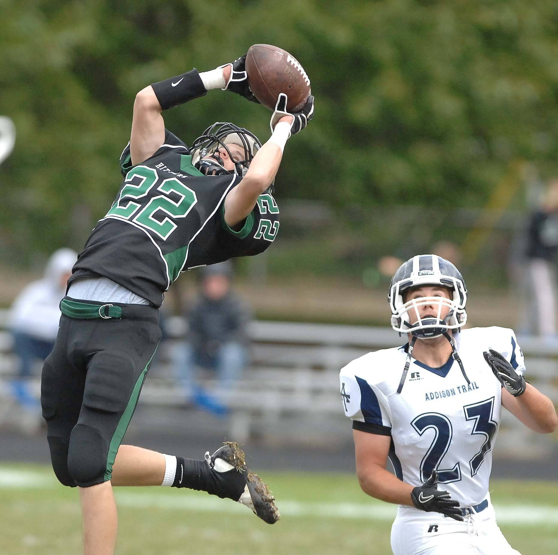 Matt Marston of Glenbard West picks off a pass intended for Nick Wisniewski during the Addison Trail at Glenbard West game Saturday.