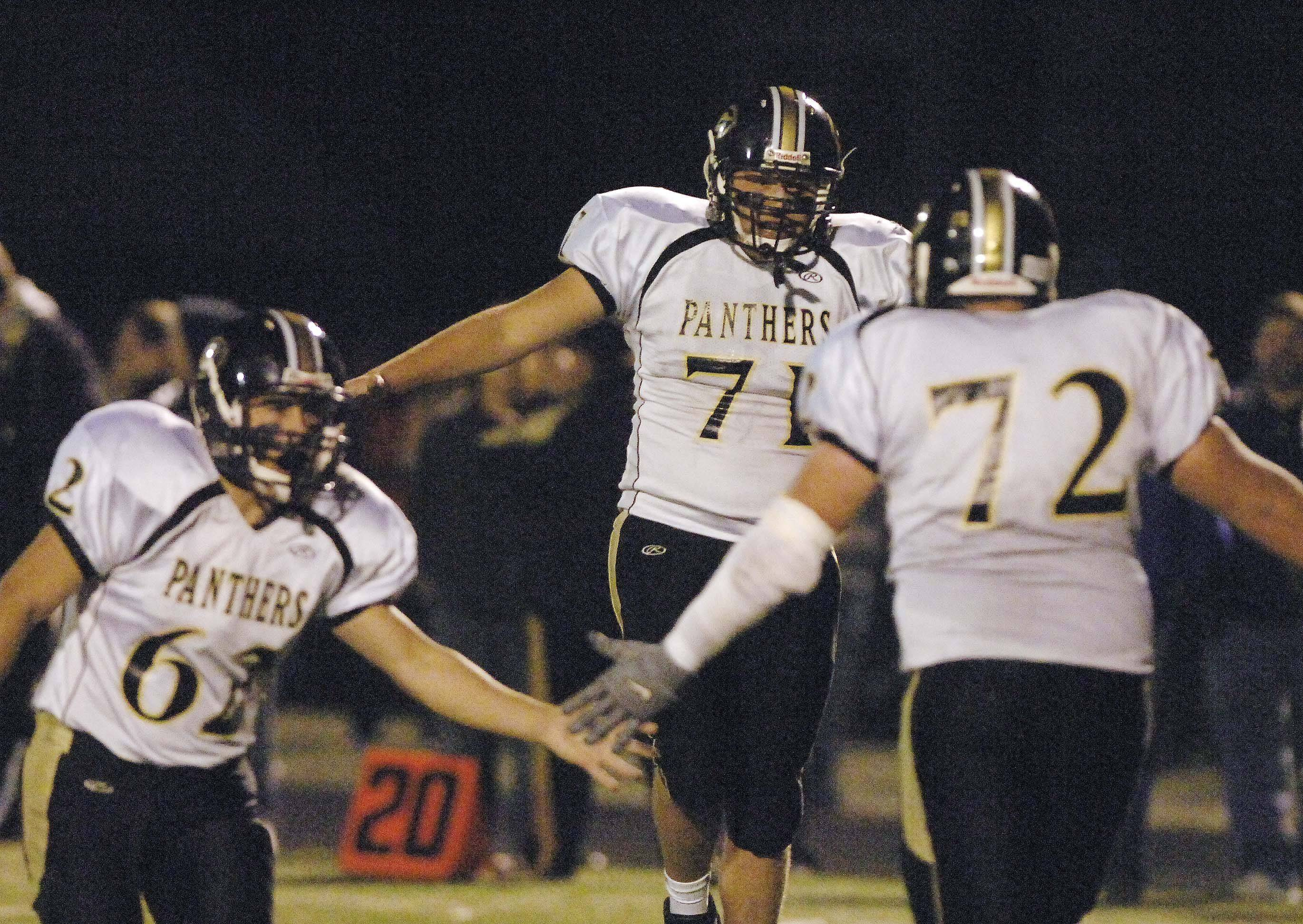 WEEK 8- Jeremy Kriese,left, Alex Wynn, and Cody Burandt of Glenbard North celebrate a touchdown.