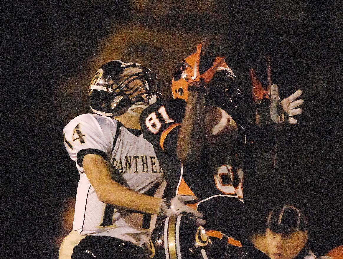 WEEK 8- Sean Fogarty of Glenbard North ,left, and Titus Davis of Wheaton Warrenville South go up for a pass.