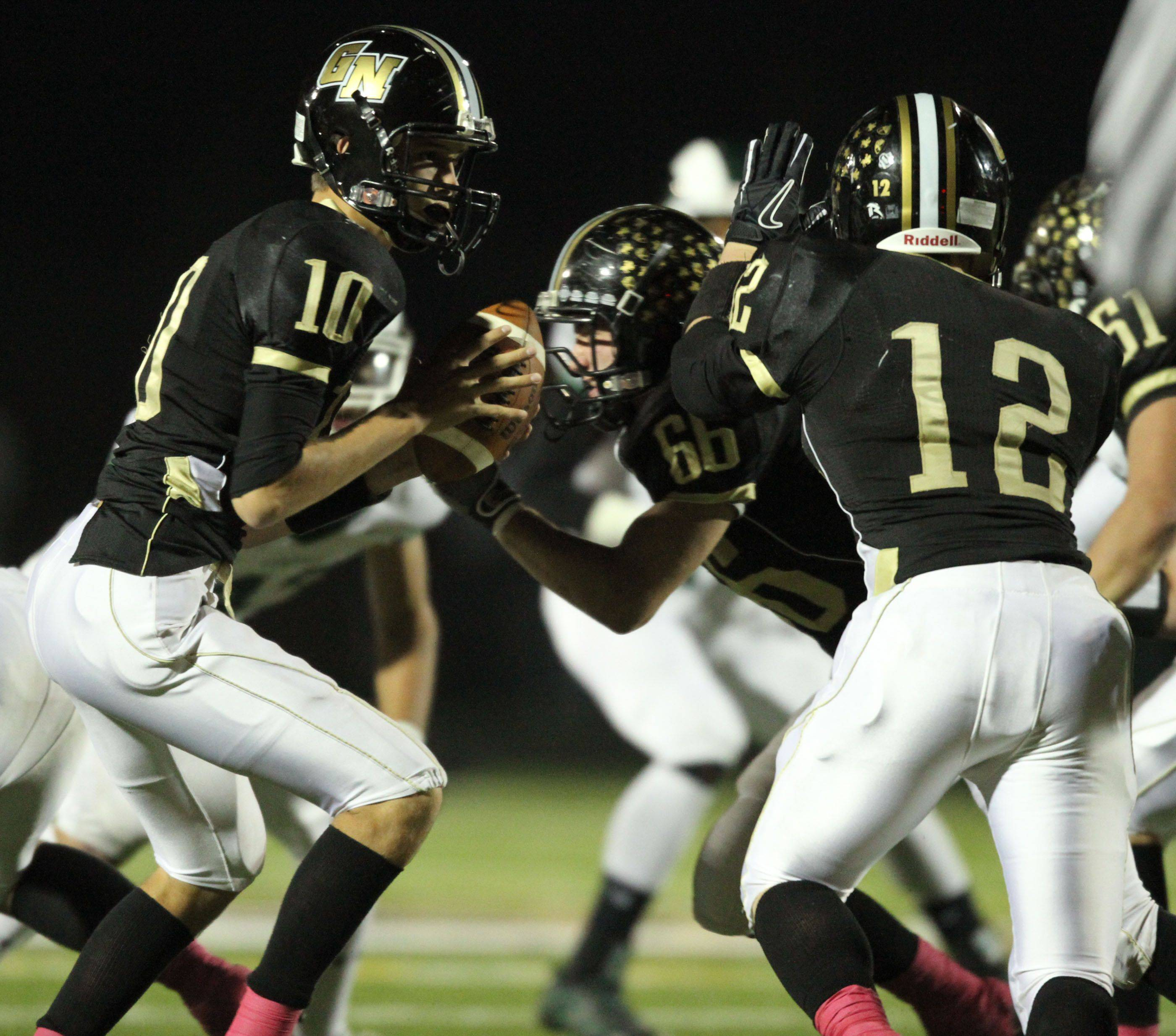 WEEK 8- Grayslake North quarterback AJ Fish looks to hand off to David Collins.