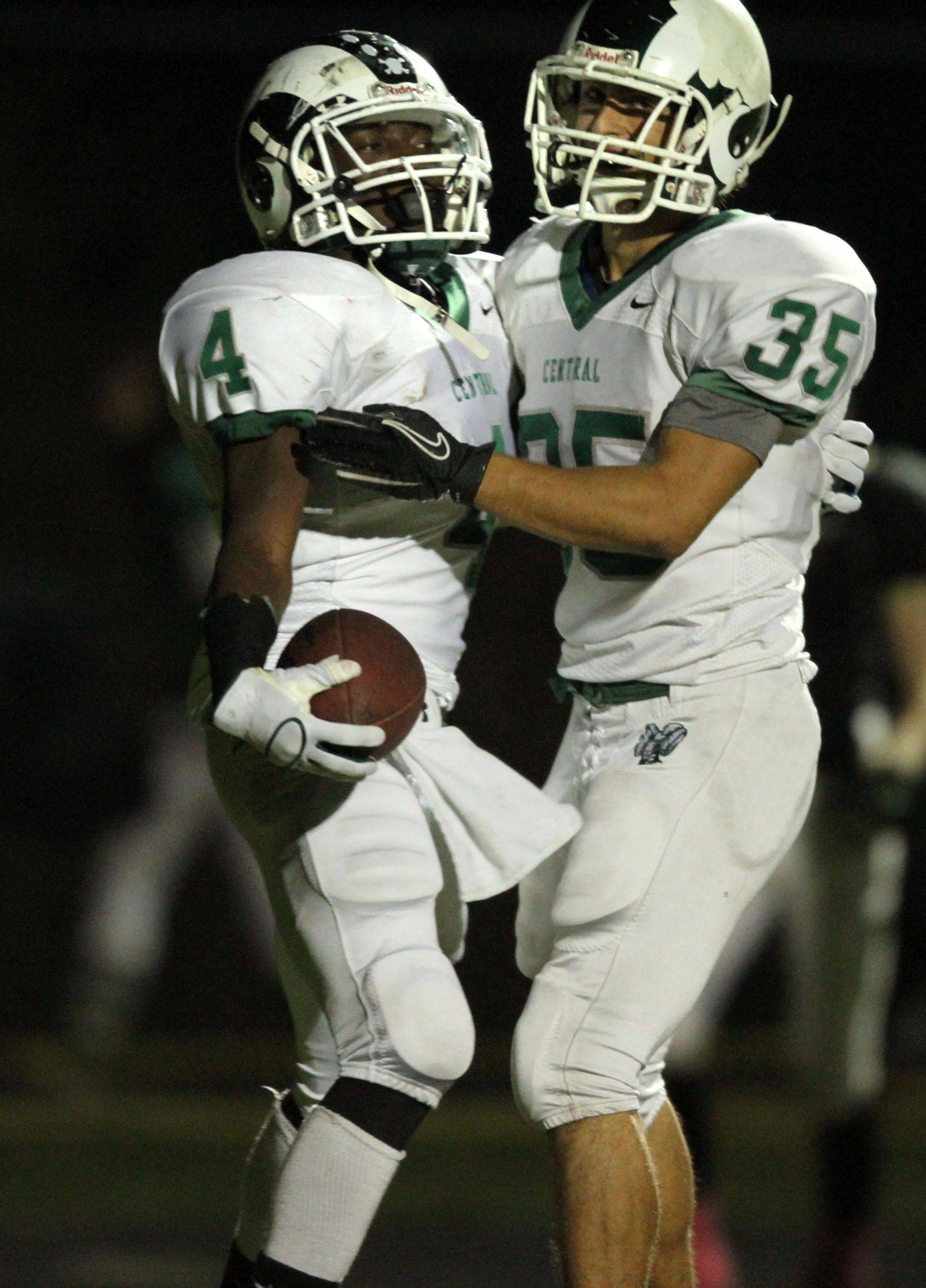 WEEK 8- Grayslake Central's Jahard Nelson gets a hand from teammate Vinnie Culhane, after running for a touchdown.