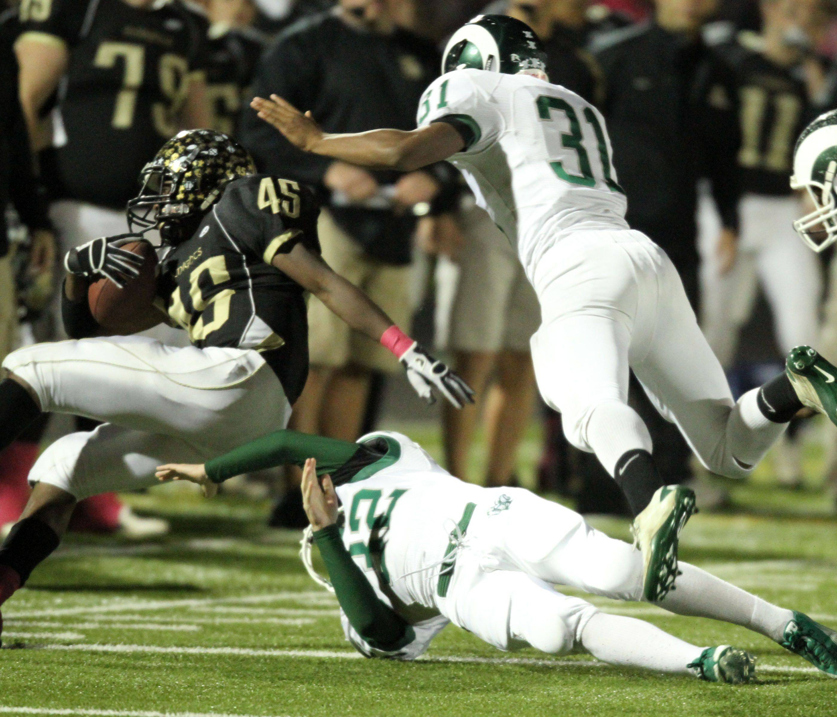 WEEK 8- Grayslake North's Kurtis Boyd is upended by Grayslake Central defenders.