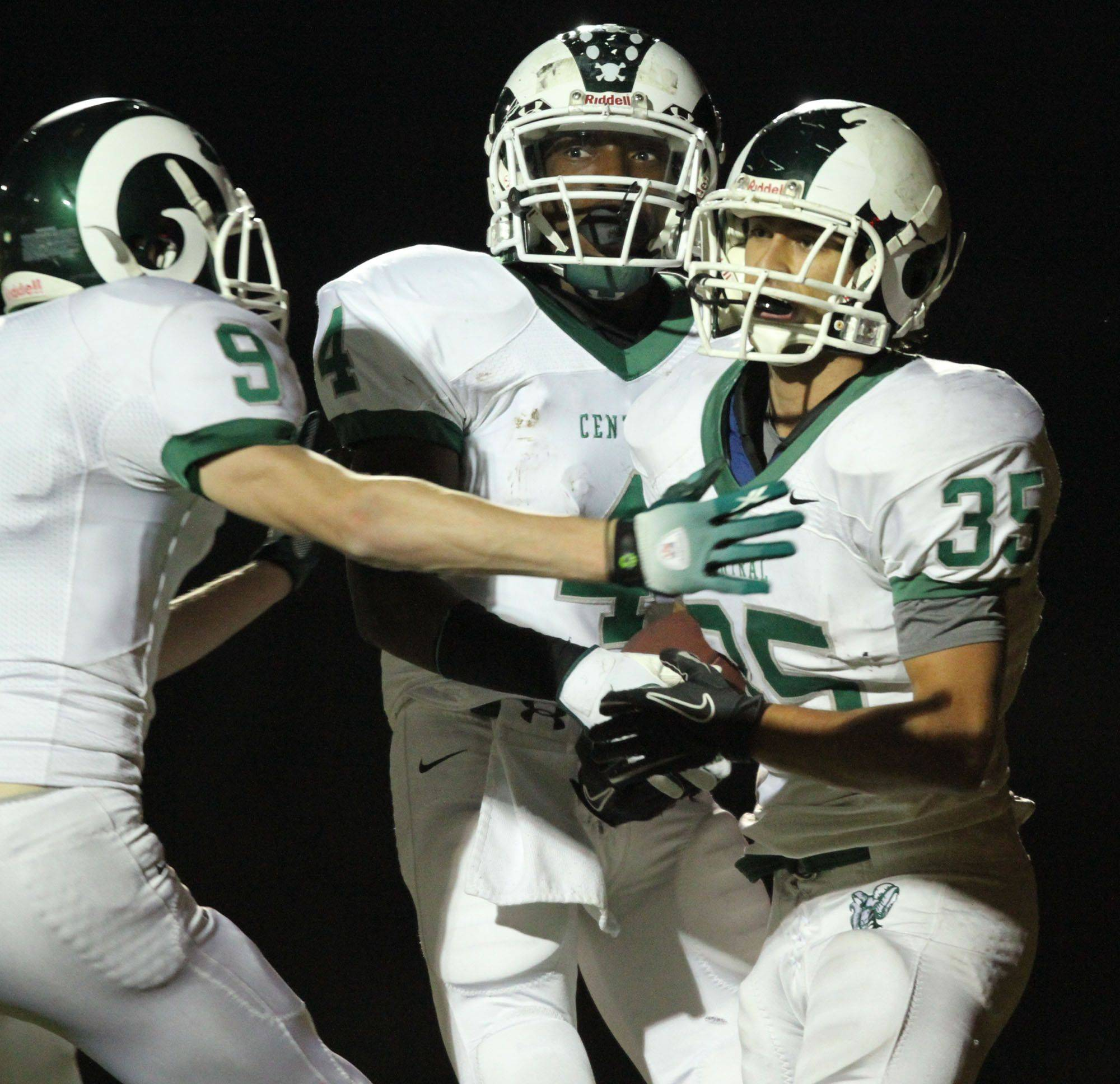WEEK 8- Grayslake Central players celebrate a touchdown by Vinnie Culhane, right.