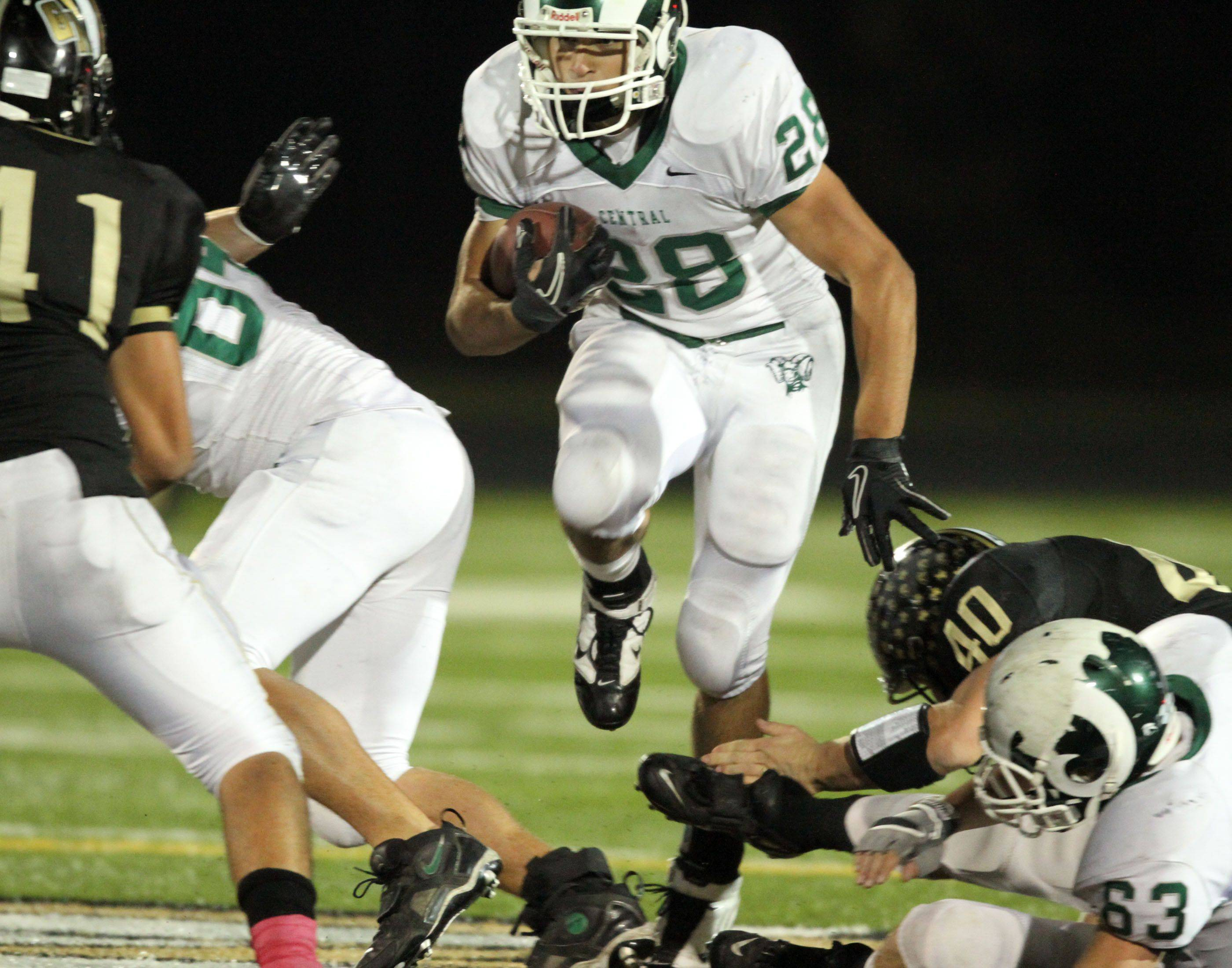 WEEK 8- Grayslake Central's Joel Valdivia runs the ball up the middle at Grayslake North.