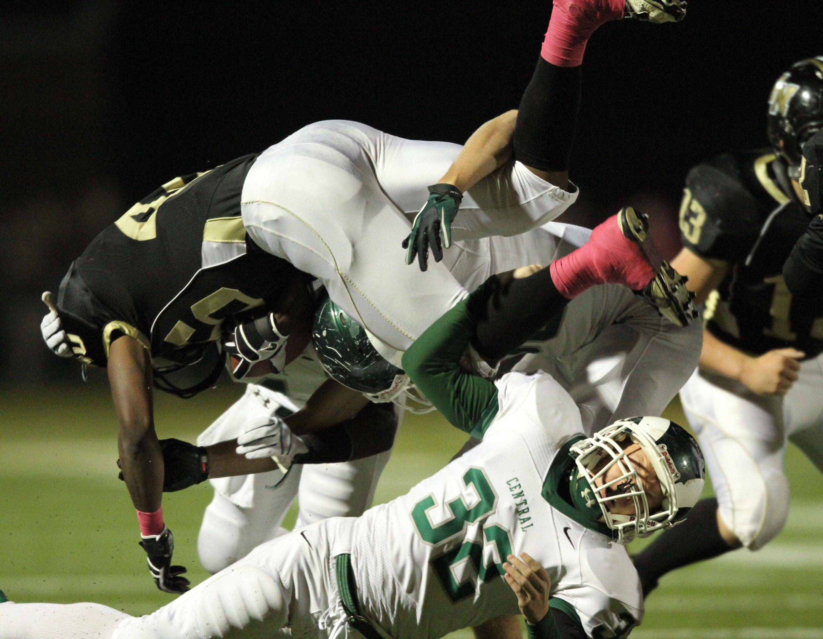 WEEK 8- Grayslake North's Kurtis Boyd is upended on a kickoff return by Grayslake Central defender CJ Stempeck.
