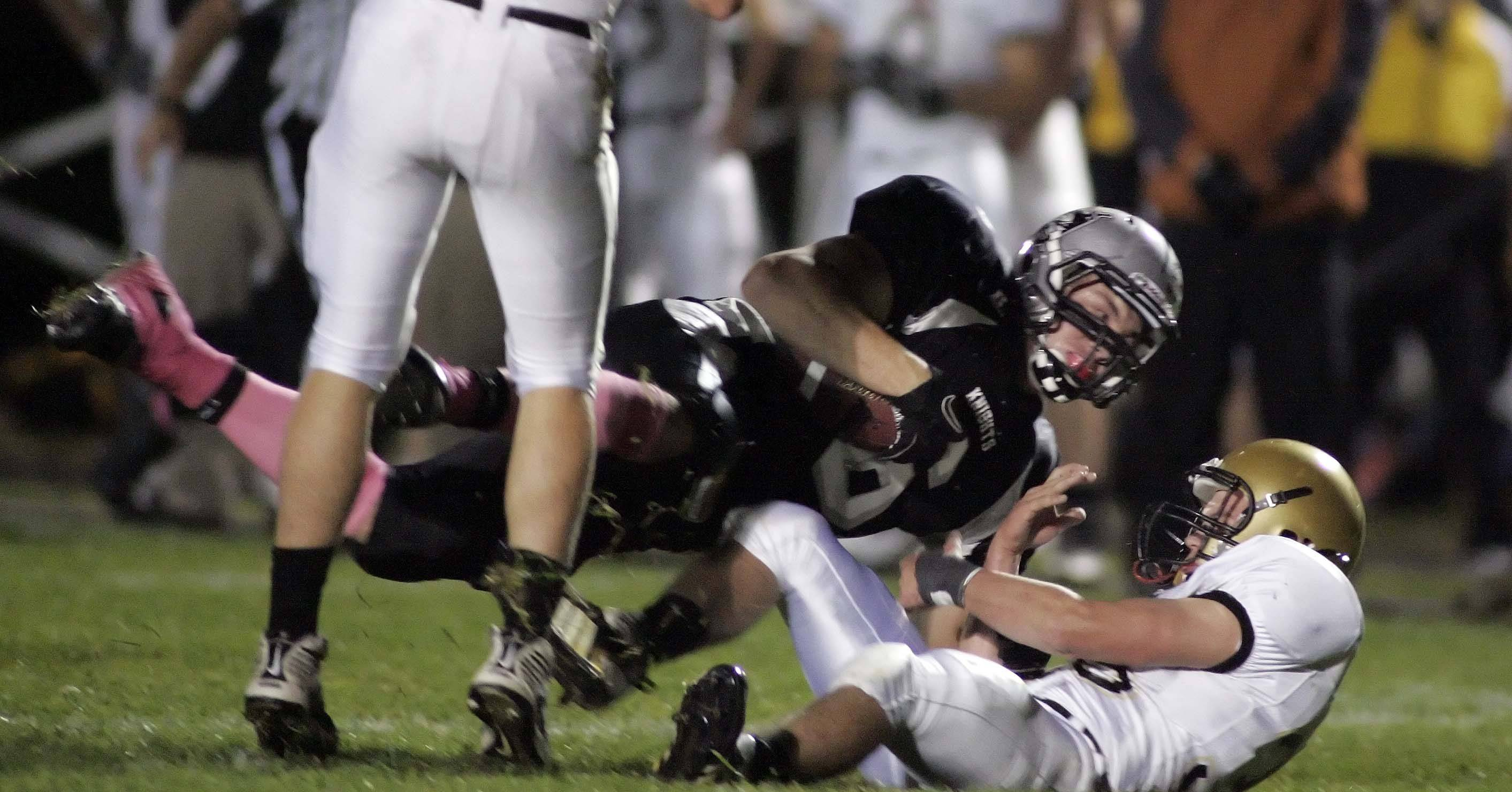 WEEK 8- Kaneland's Tyler Callaghan picks up some yardage.