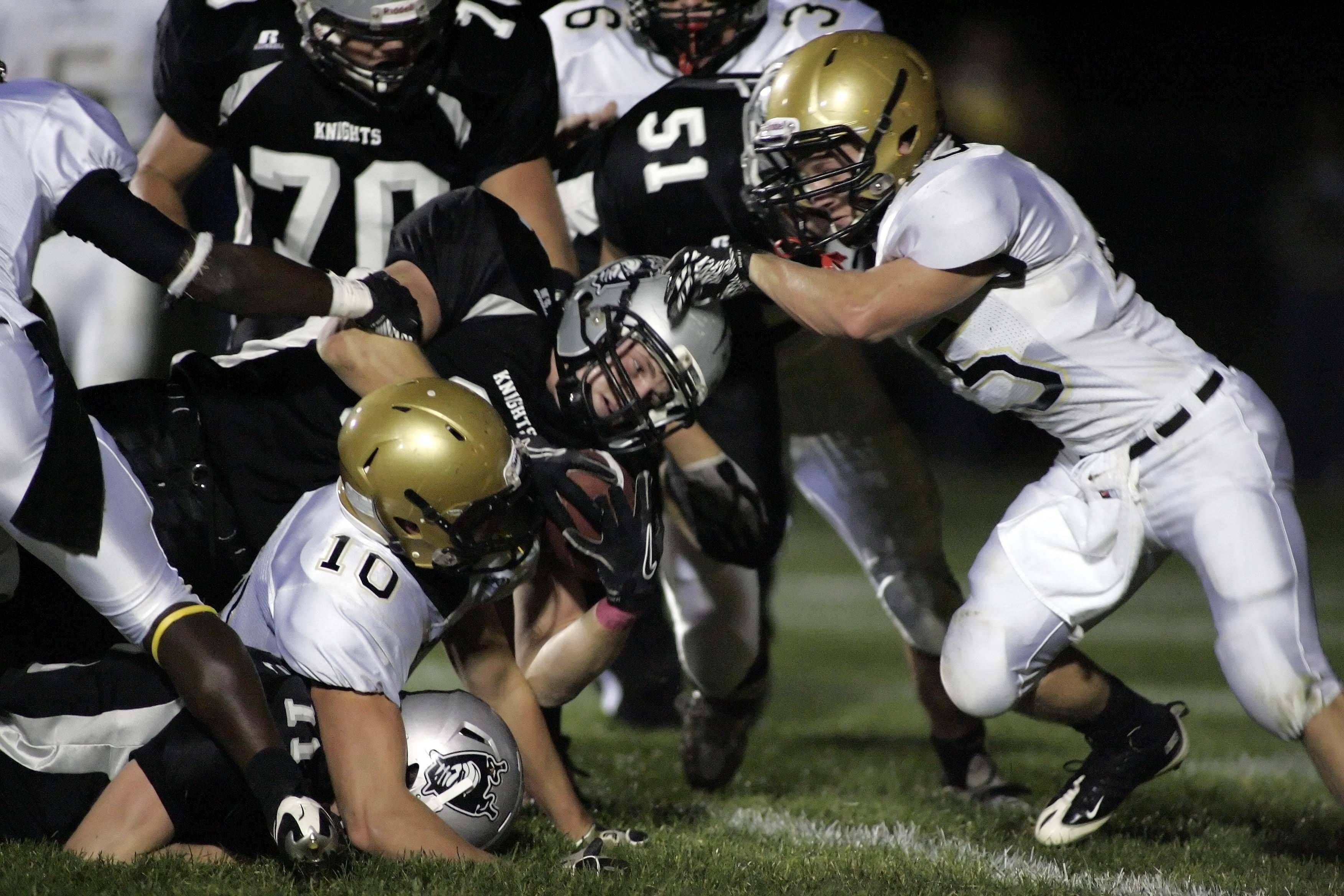 WEEK 8- Kaneland's Blake Serpa goes head-first into a pile.