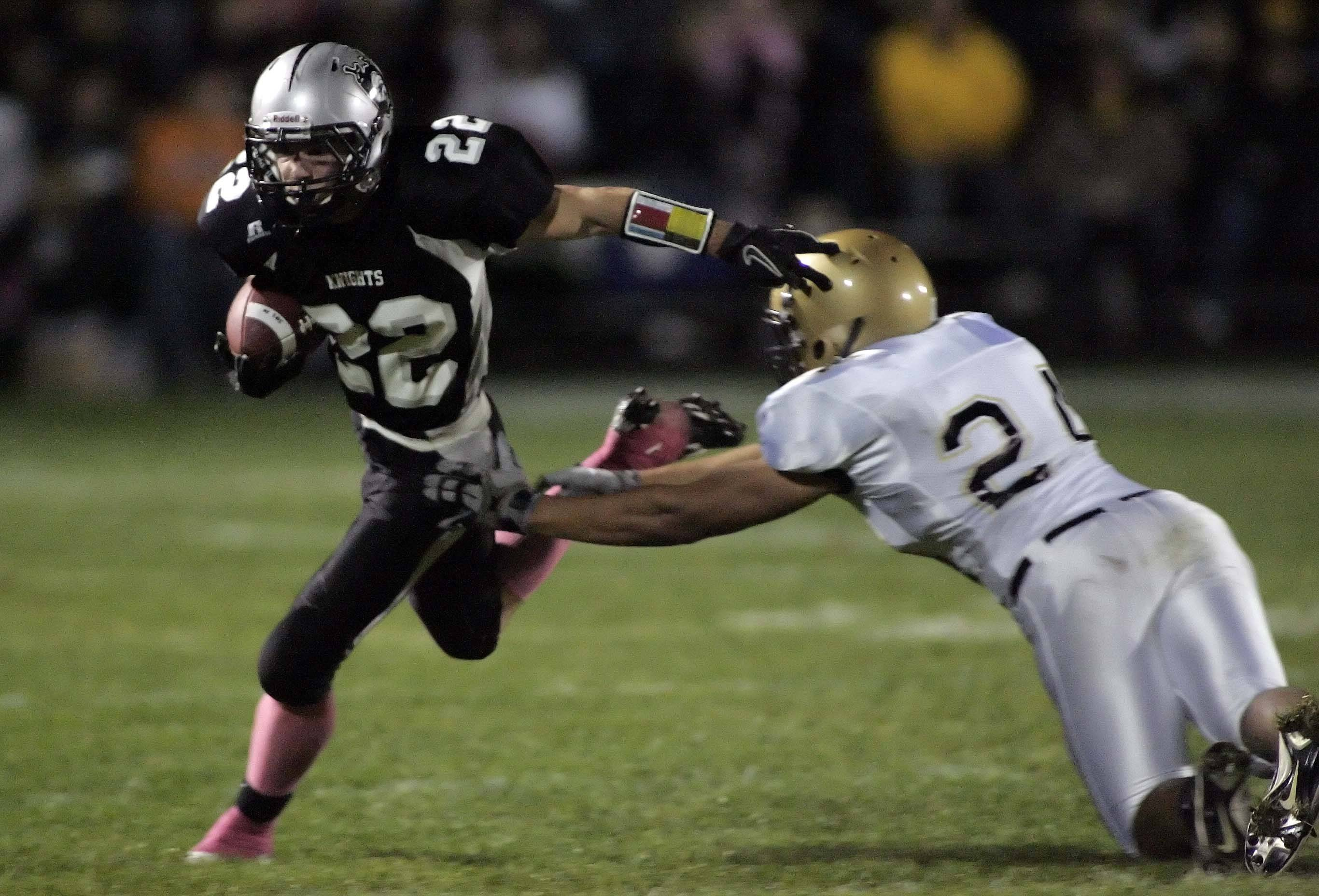 WEEK 8- Kaneland's Quinn Buschbacher works upfield past Sycamore's Marcus Dominguez.