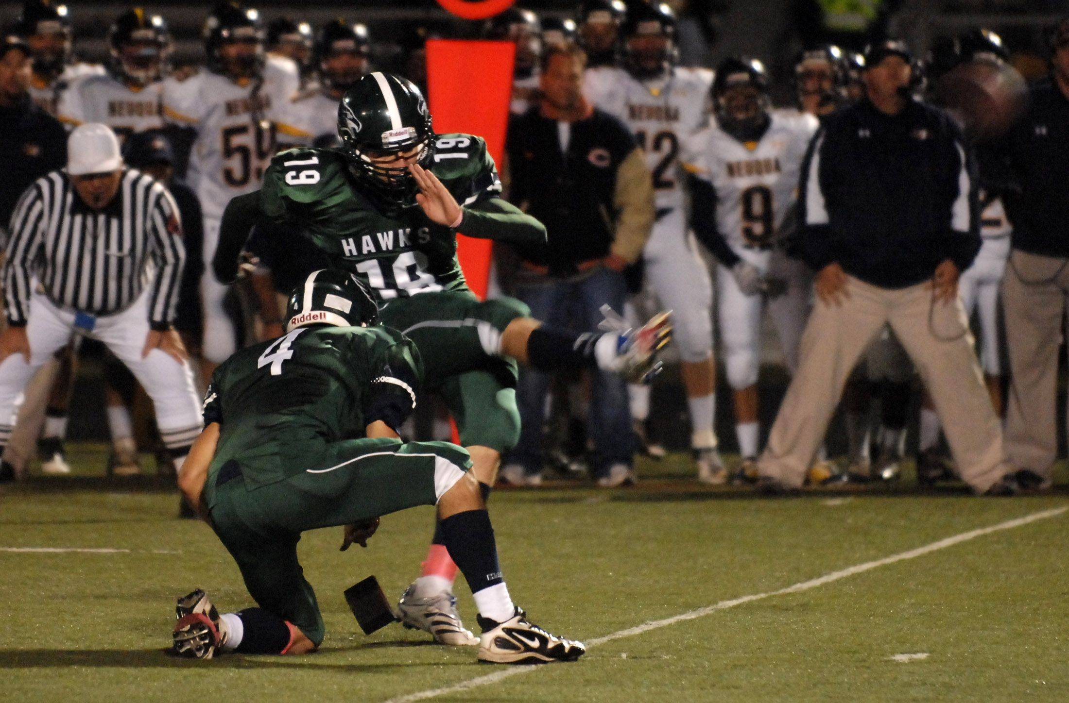 WEEK 8- Bartlett's Ian Dobek kicks what would turn out to be the game-winning field goal against Neuqua Valley .