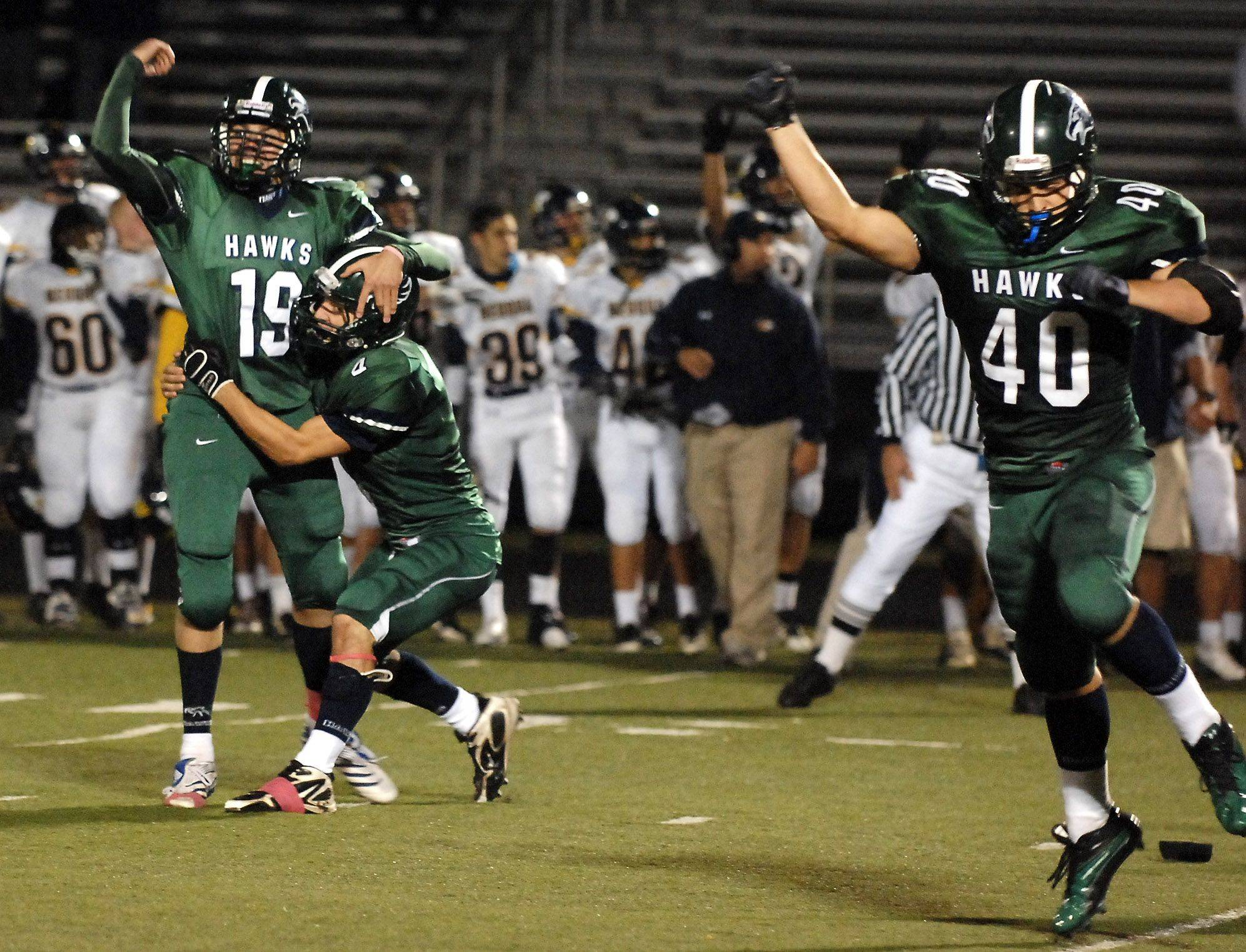 WEEK 8- Bartlett kicker Ian Dobek celebrates with holder Joey Scaminaci after kicking a 35-yard field goal with about 40 seconds left to give the Hawks a 25-23 lead .
