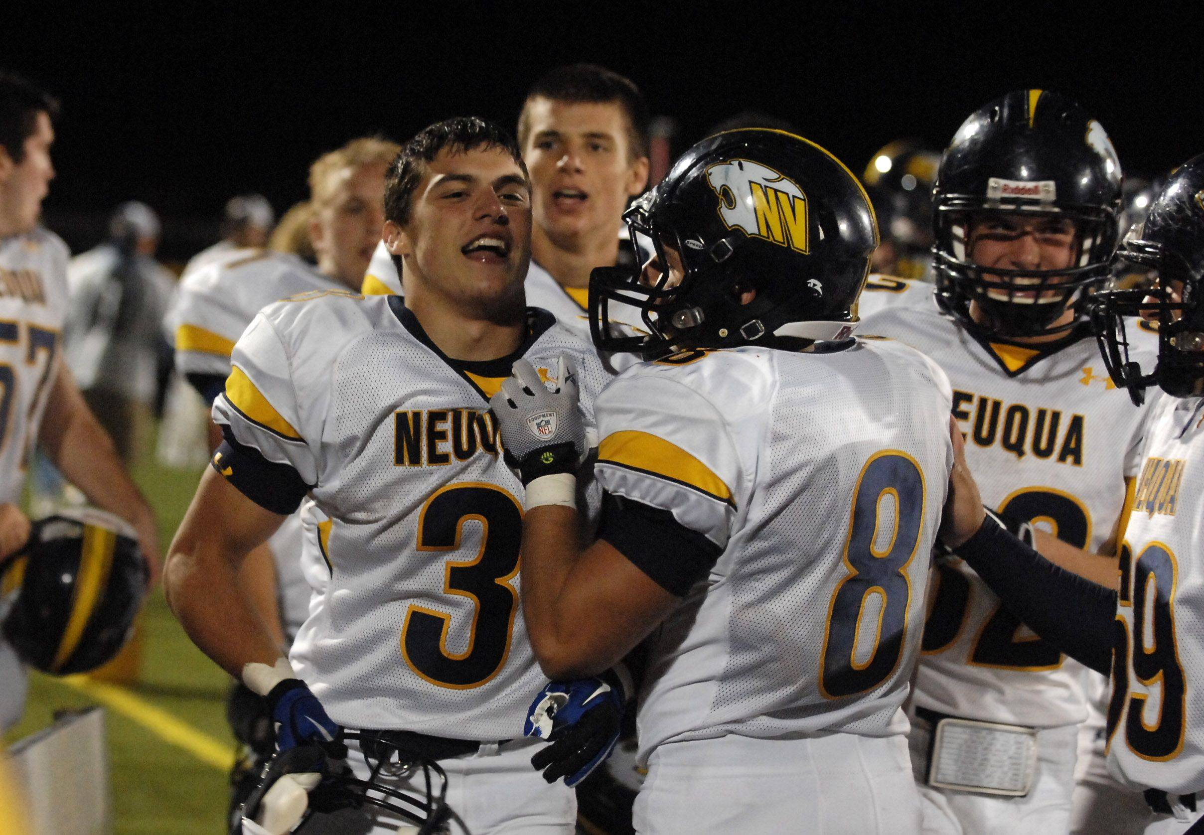 WEEK 8- Neuqua Valley teammates congratulate Dillon Strack after he returned the opening kickoff of the second half for a touchdown against Bartlett.