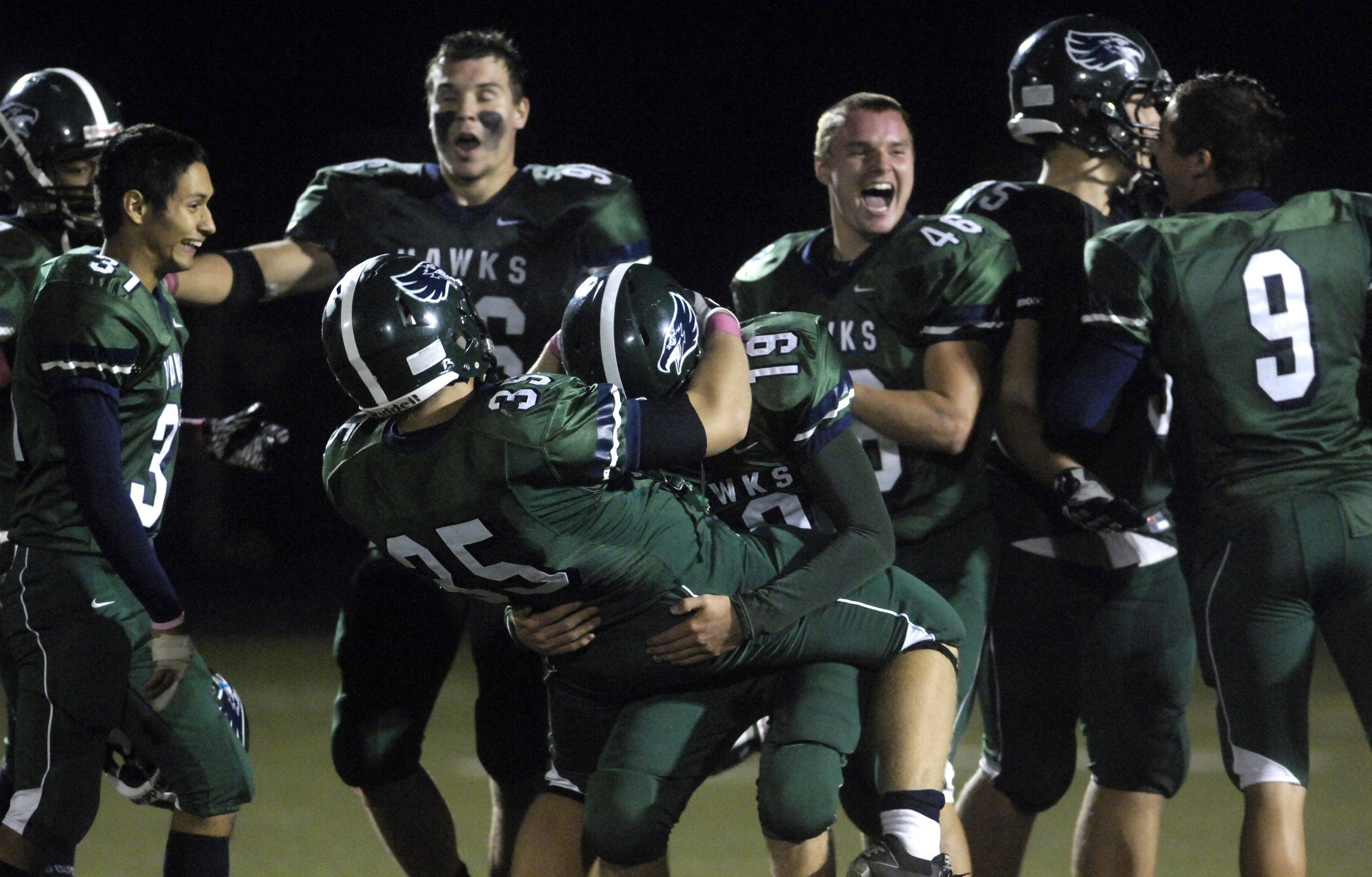 WEEK 8- Bartlett's Ian Dobek and Andrew Parent are joined by teammates on the field after beating Neuqua Valley.