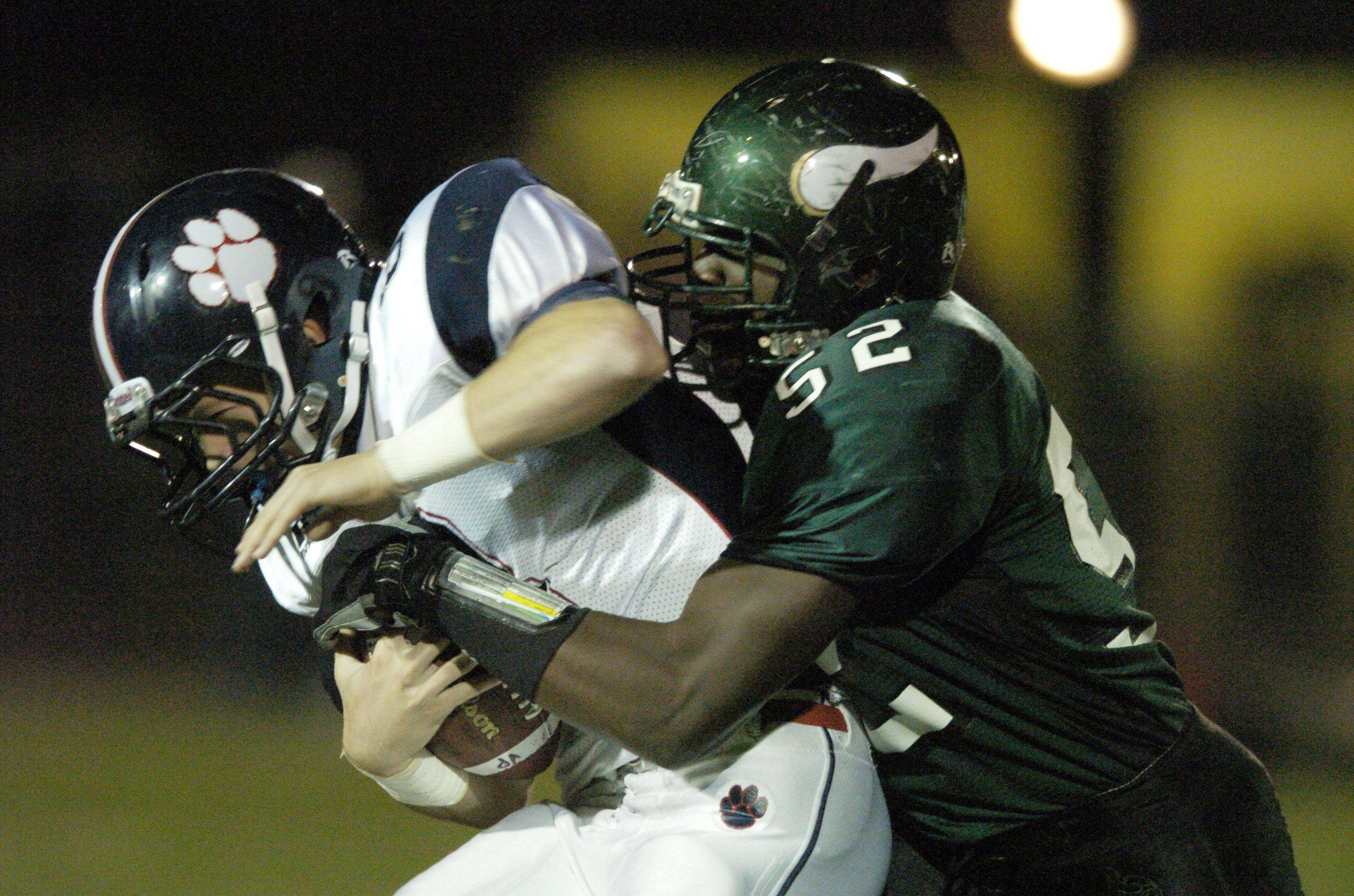 WEEK 9- Conant's Matt Cullen gets tackled by Fremd's Jeffrey Parham .