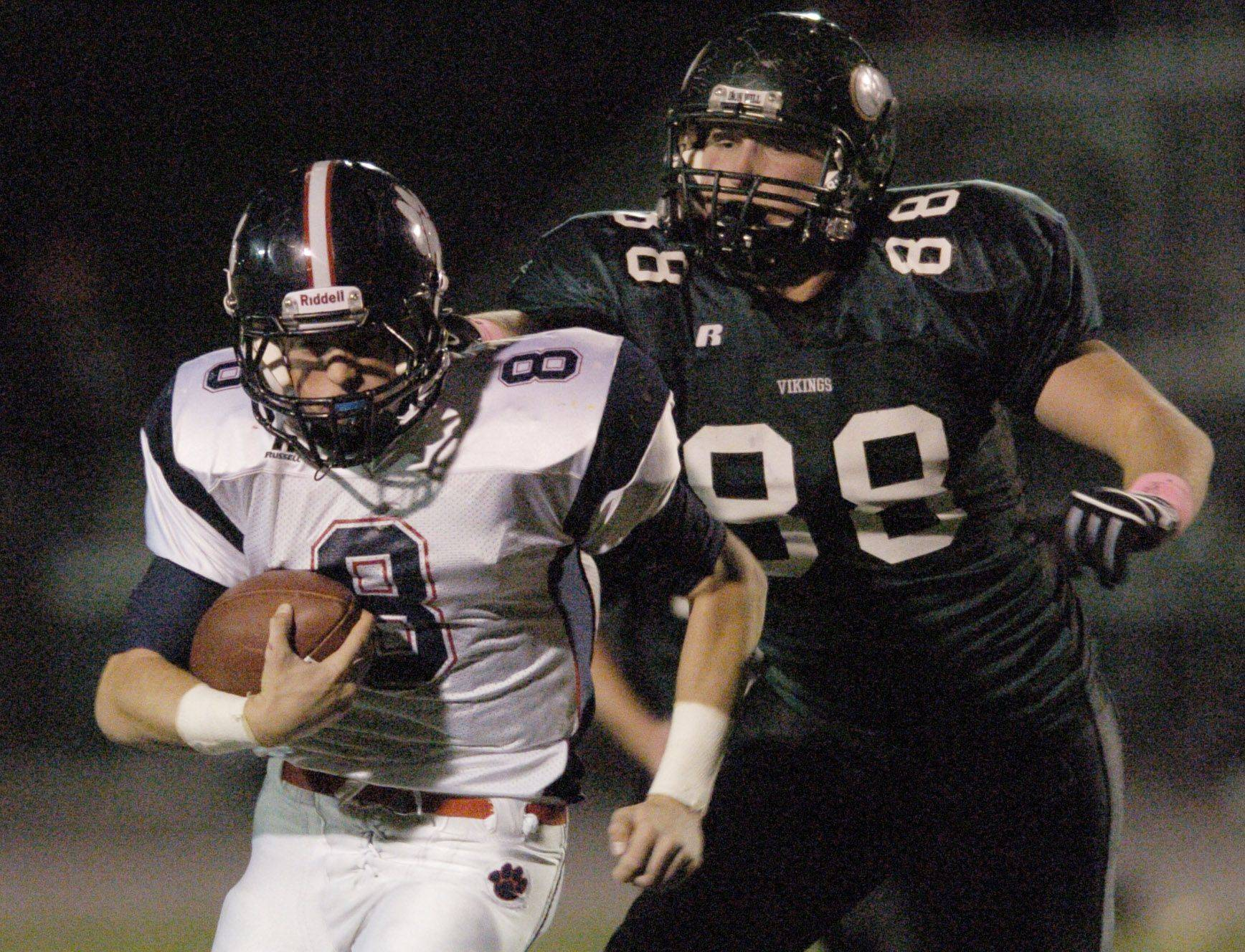 WEEK 9- Conant quarterback Matt Cullen is pursued by Fremd's Jack Konopka.