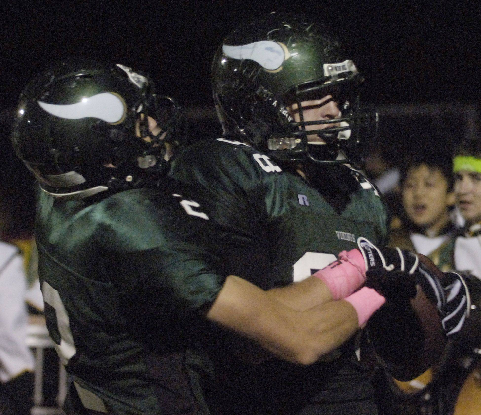 WEEK 9- Fremd's Jack Konopka, right, celebrates his fourth-quarter touchdown with teammate Troy Cutler.
