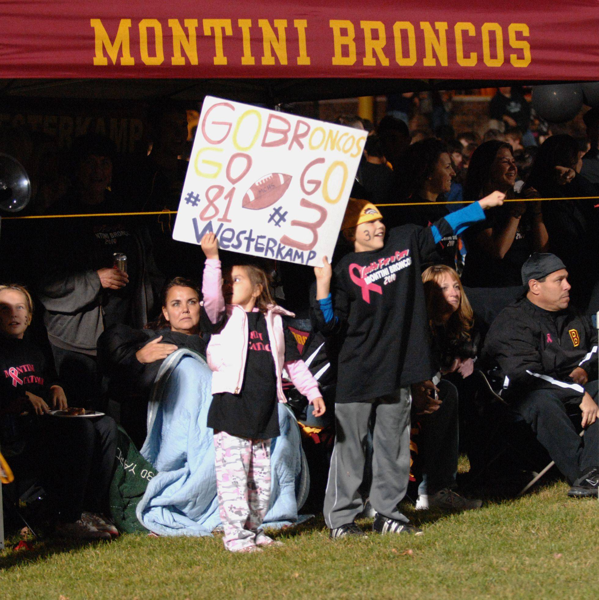 WEEK 9- Young Montini fans, holding a sign bearing Jordan Westercamp's name, cheer after he scored a touchdown vs. Marmion Academy .