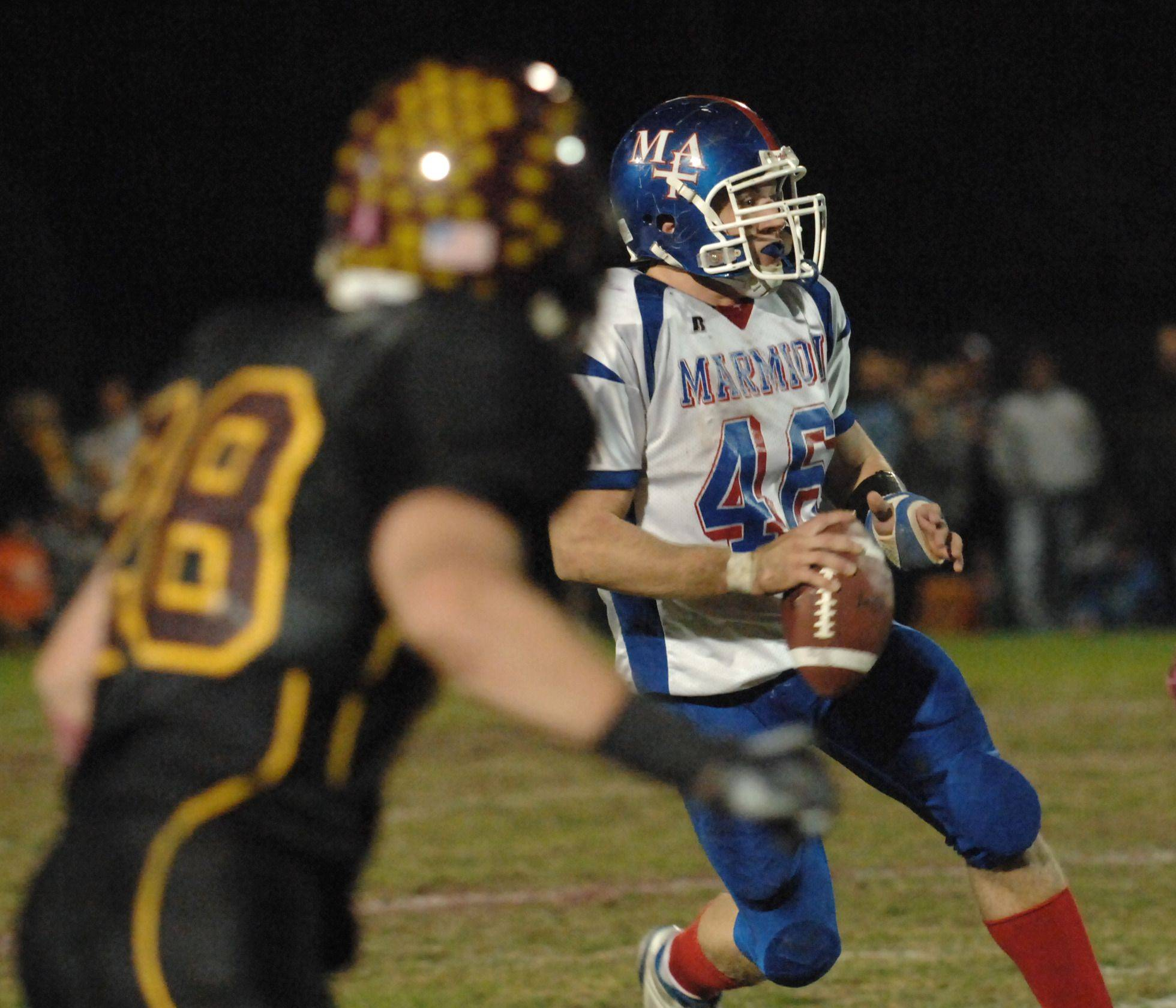 WEEK 9- Marmion Academy's T.J. Lally looks to pass .