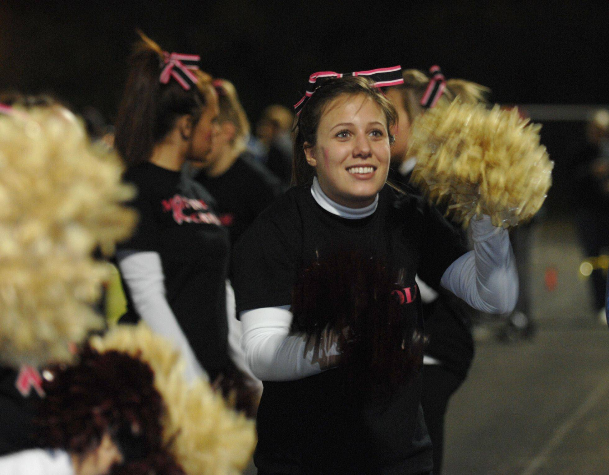 WEEK 9- A Montini cheerleader entices the crowd.