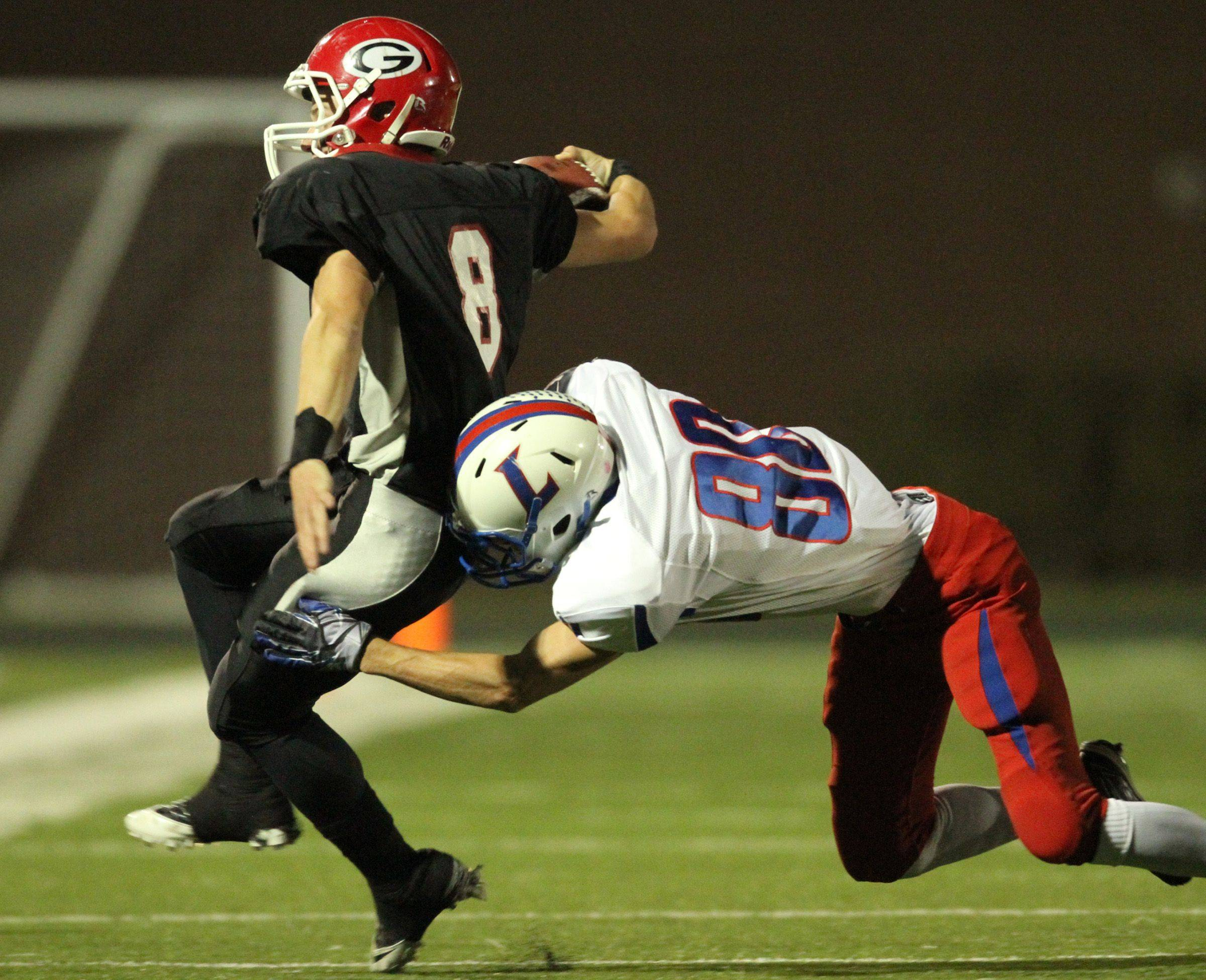 WEEK 9- Lakes defender Josh Pohlman knocks Grant's Leo Minne out of play .