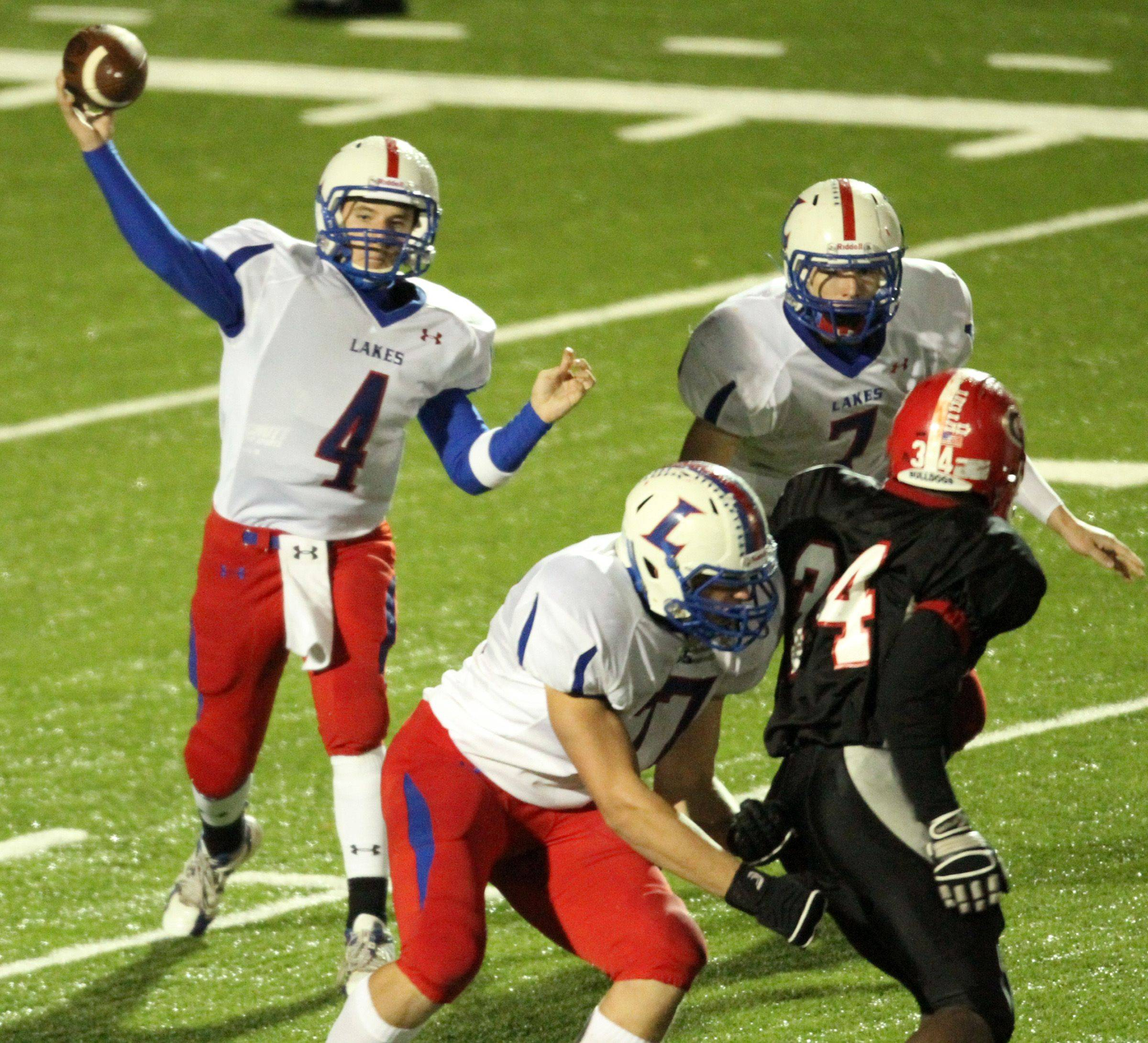 WEEK 9- Lakes quarterback Jeff Eder passes the ball against Grant.