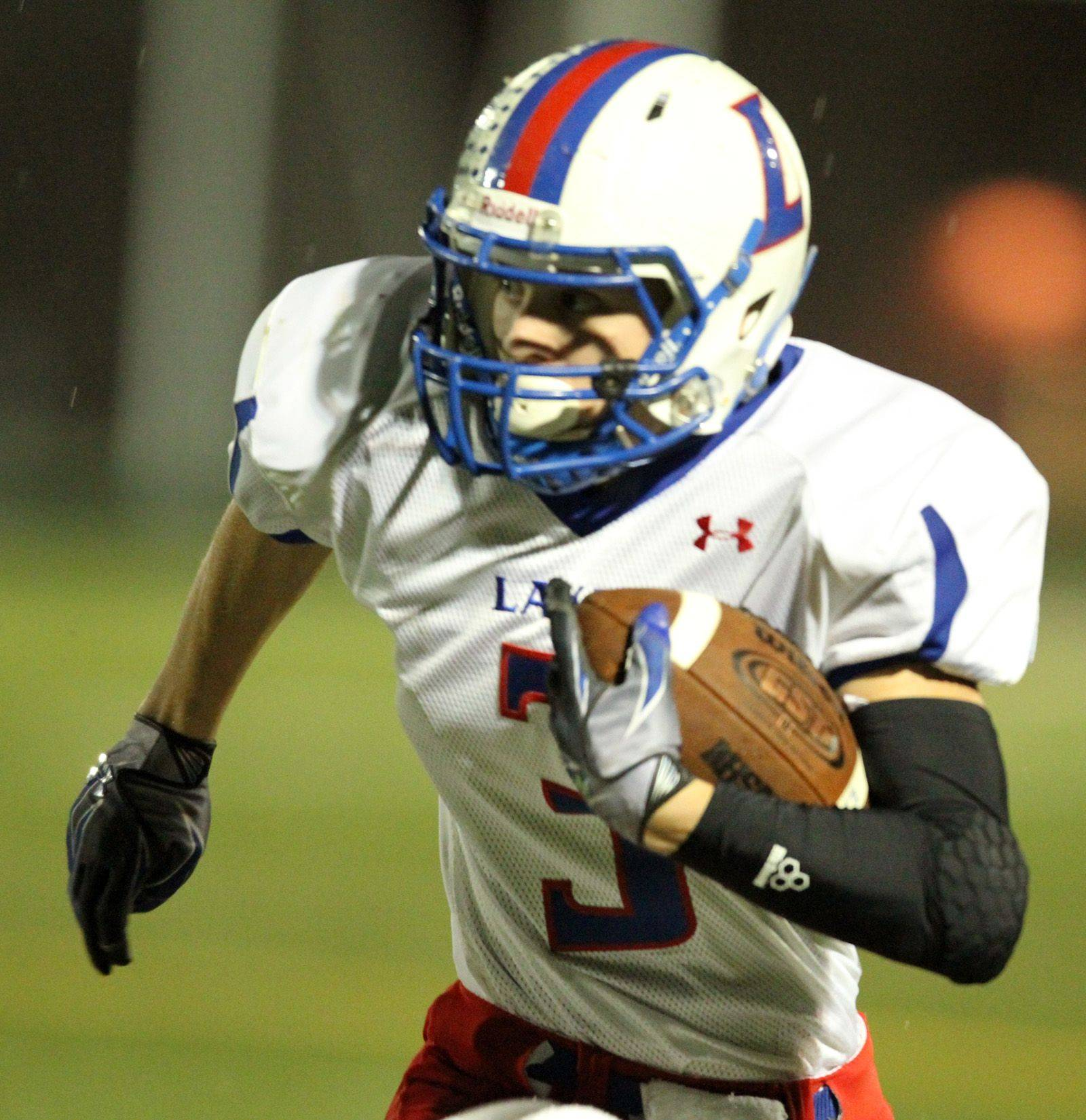 WEEK 9- Lakes' Mike Hough runs the ball against Grant.