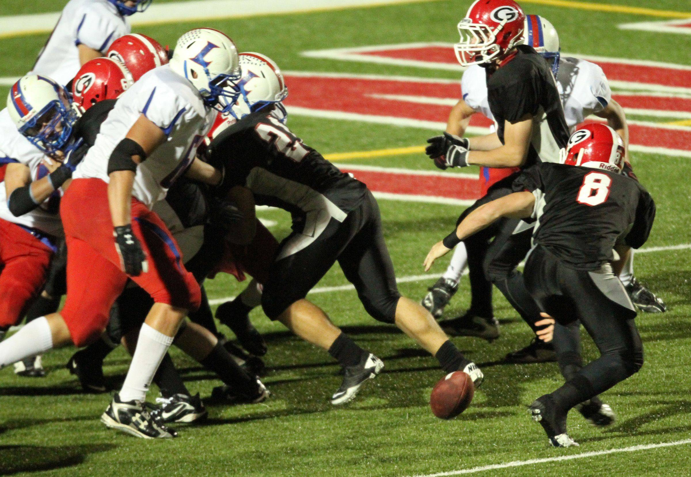WEEK 9- Grant's quarterback Leo Minnie losses the ball in the red zone.