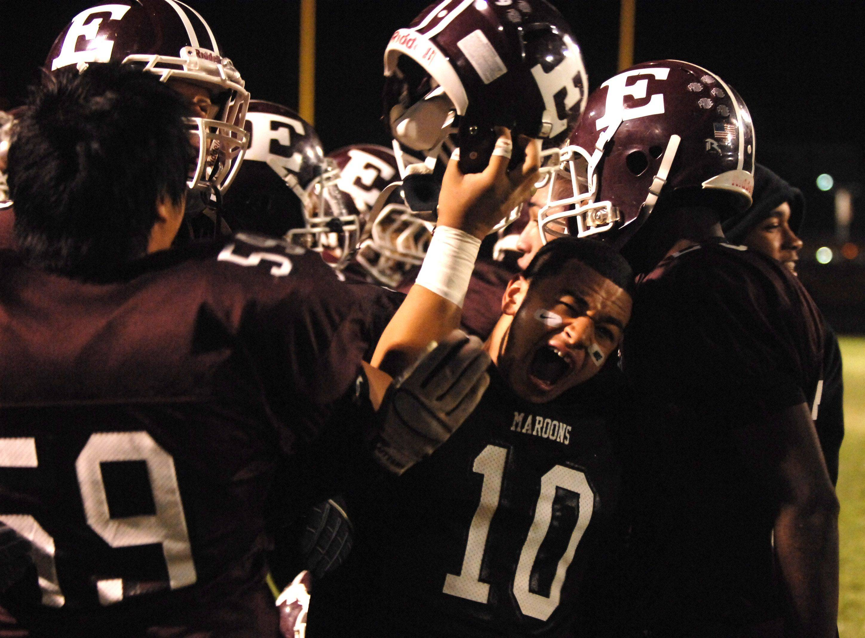 WEEK 9- Will Wood and his Elgin teammates celebrate securing a playoff berth after beating Metea Valley .