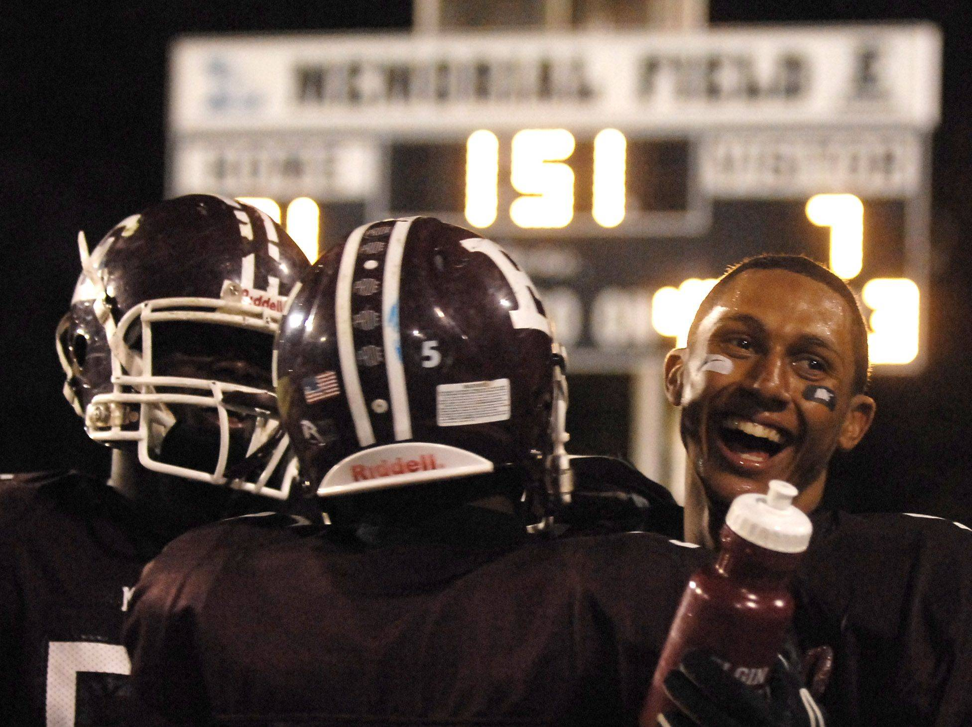 WEEK 9- Elgin's Devin Gilliam, right, is congratulated by teammates after a touchdown against Metea Valley .