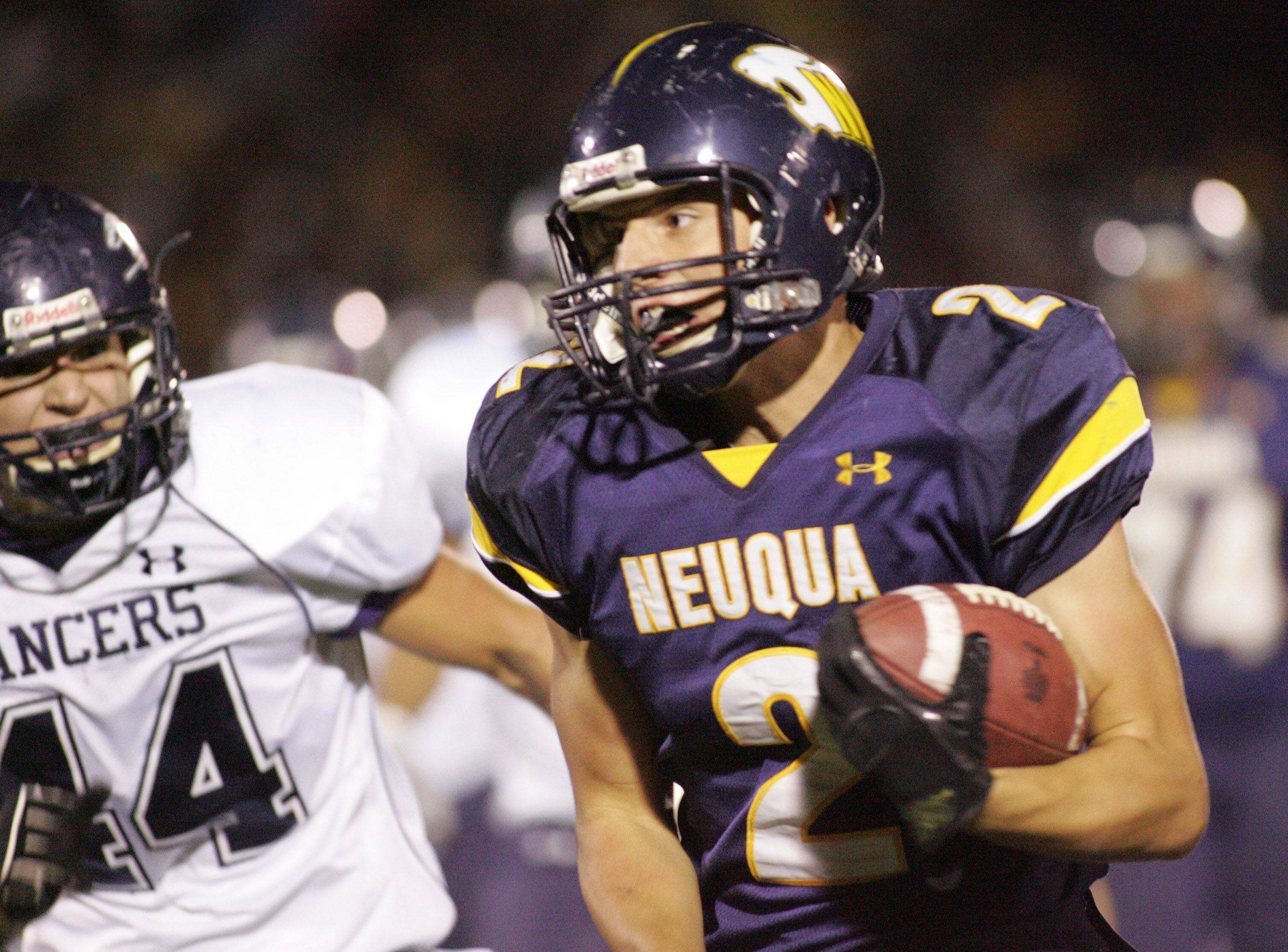 WEEK 9- Jack Norgaard of Neuqua valley runs past Lake Park players .