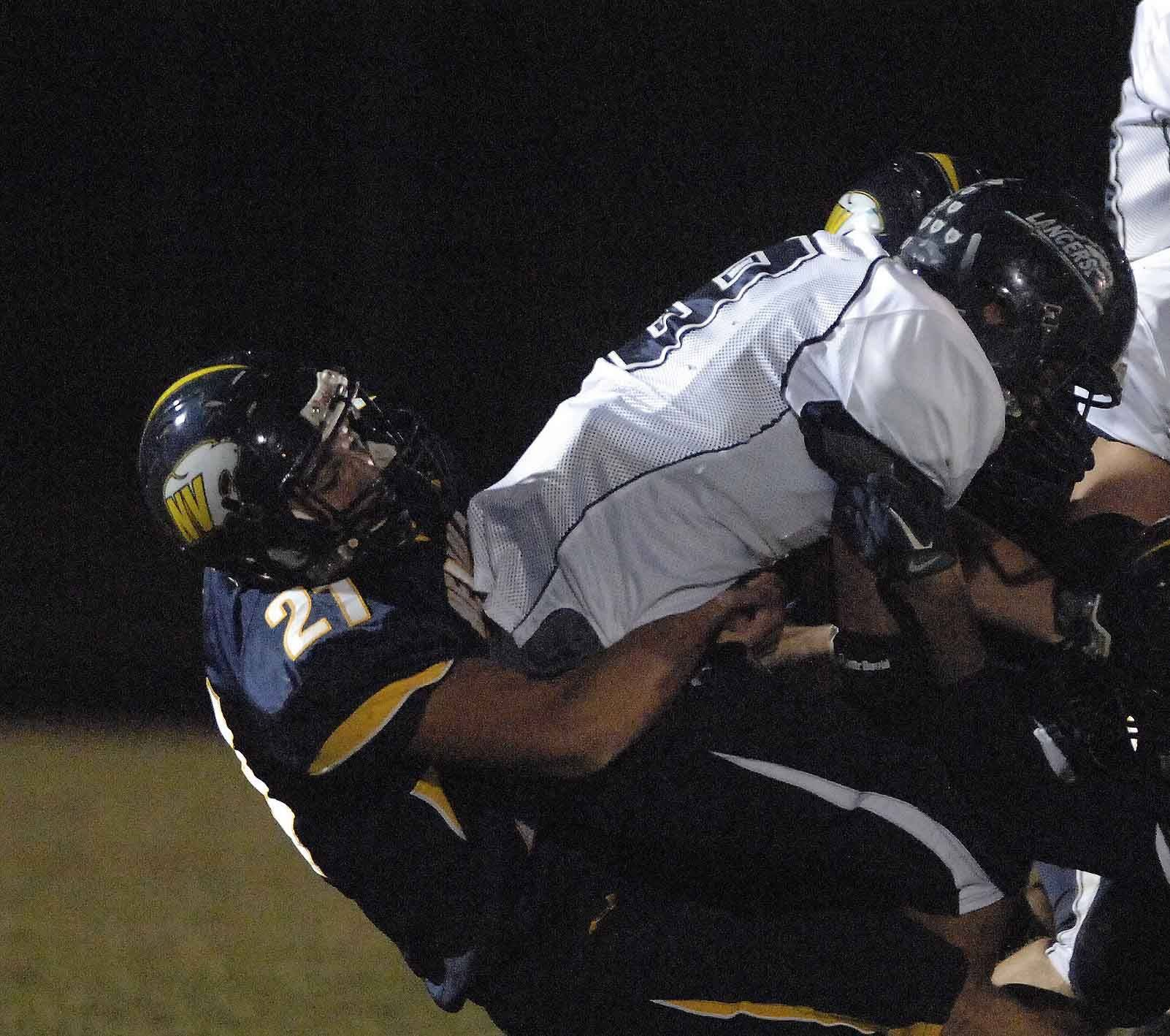WEEK 9- Andrew Skonkwiler of Neuqua Valley pulls down Chris Kowalski of Lake Park.
