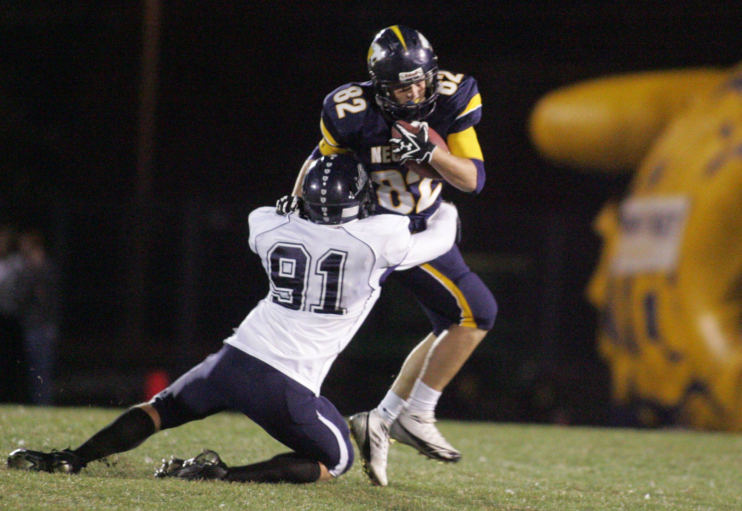 WEEK 9- Neuqua Valley's Jeff Evak gets tackled shortly after receiving a punt.