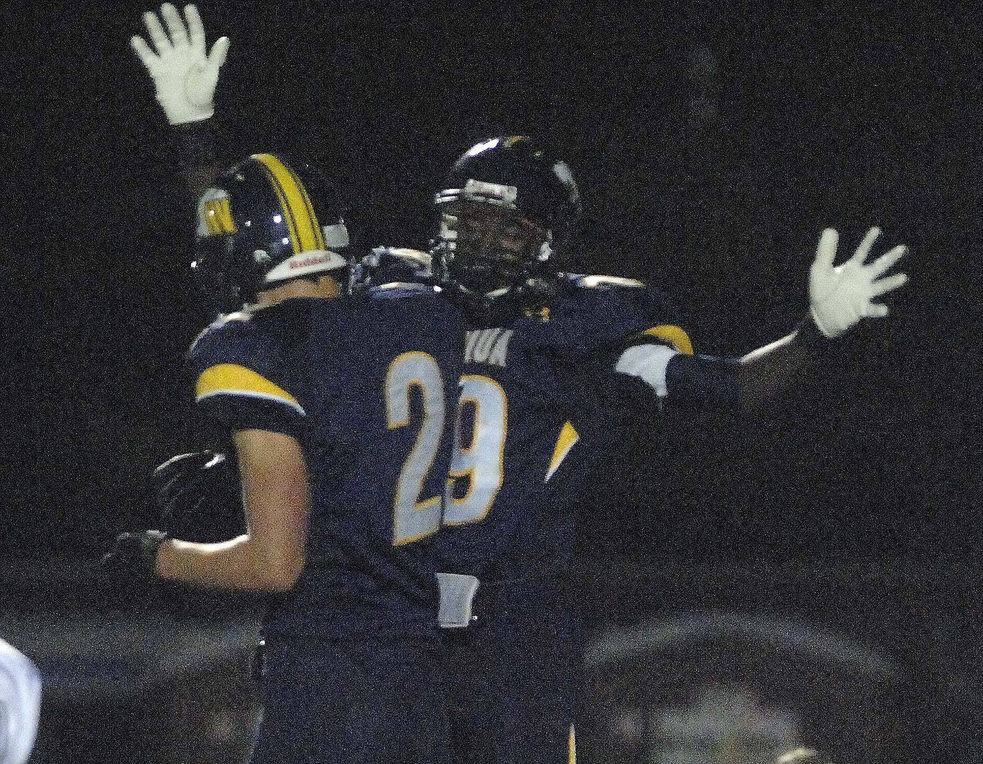 WEEK 9- Jack Norgaard,left, and Evan Jackson of Neuqua Valley celebrate .