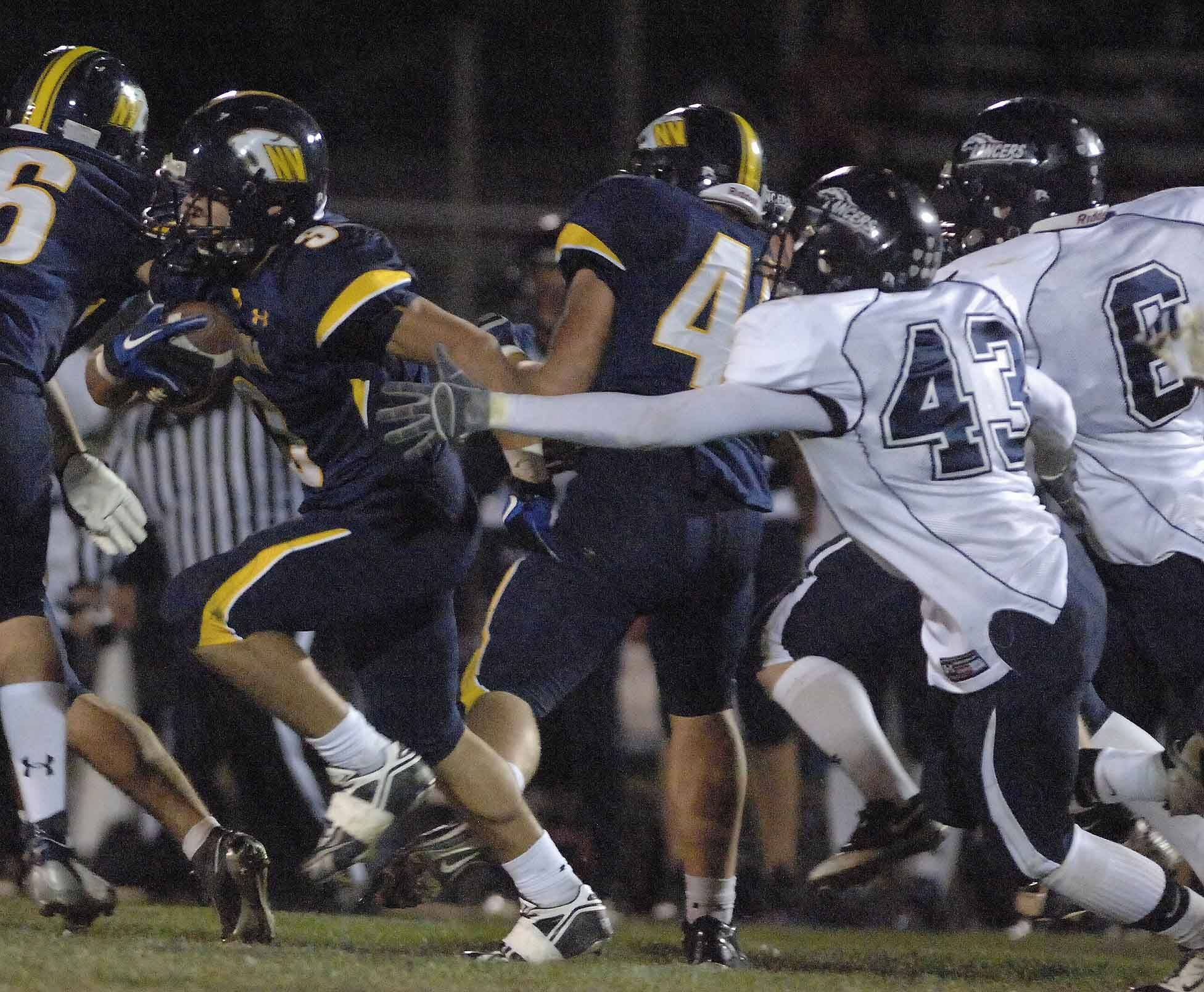 WEEK 9- Dillion Strack of Neuqua Valley,left, is pursued by Scott Granfeldt of Lake Park.
