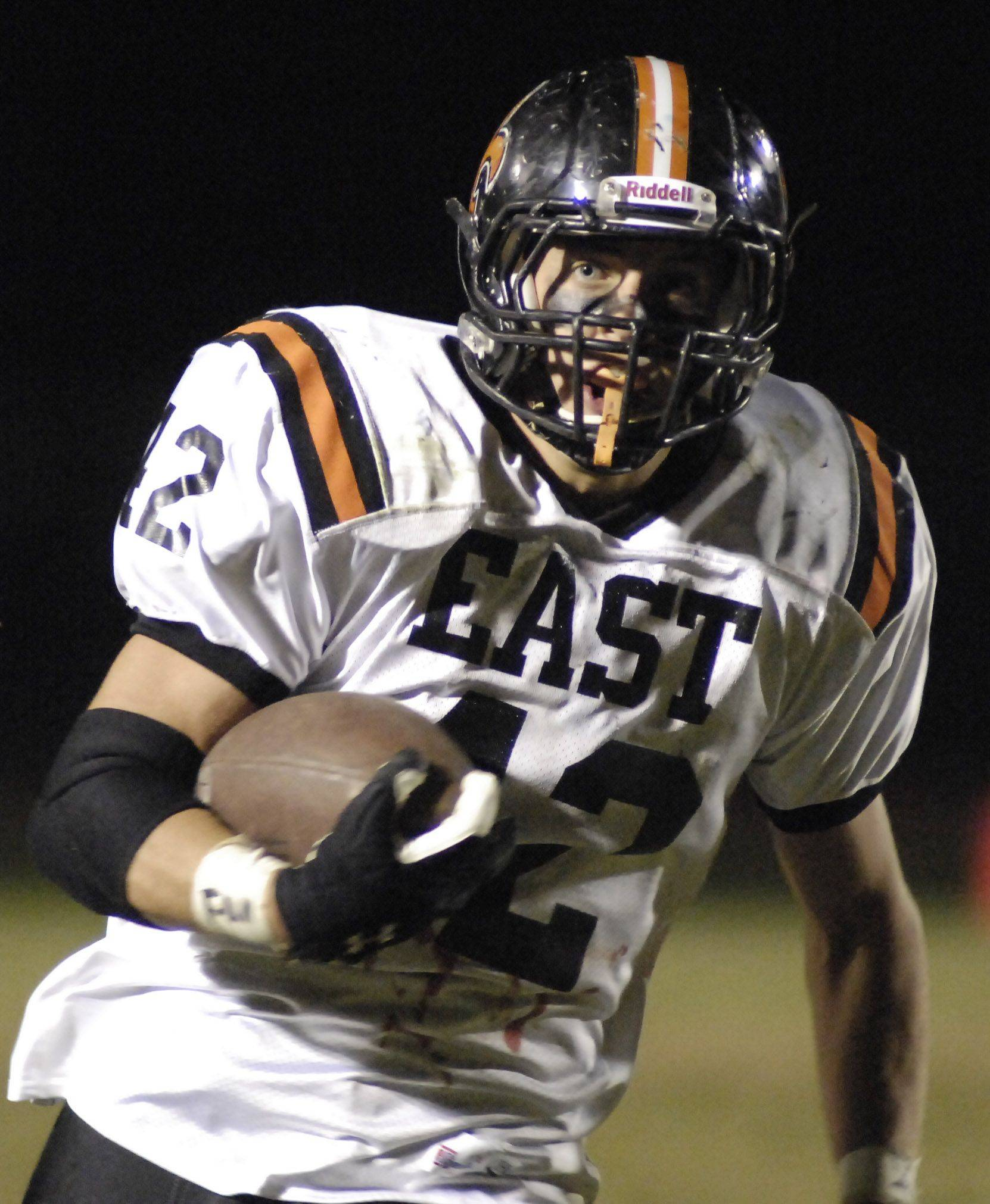 WEEK 9- St. Charles East's Joe Hoscheit runs up the sideline in the second quarter .
