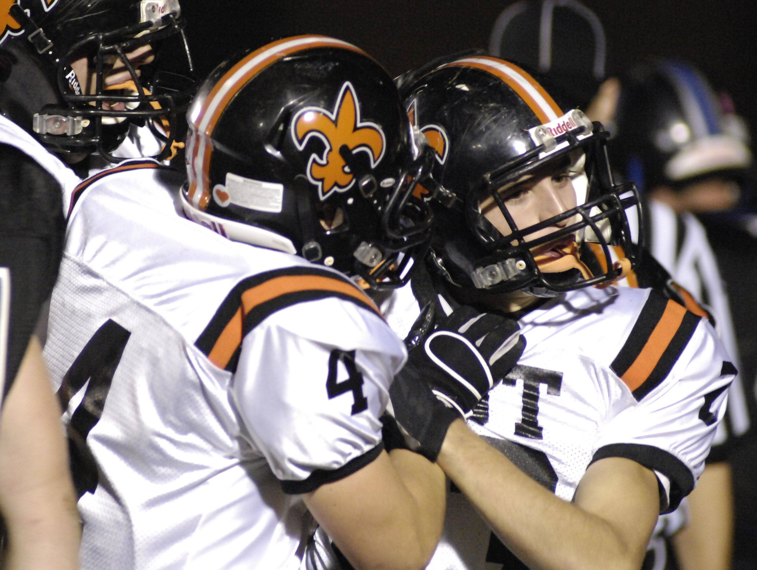 WEEK 9- St. Charles East's Carter Reading, right, is congratulated by teammate Kyle Lanthier after a touchdown in the first quarter